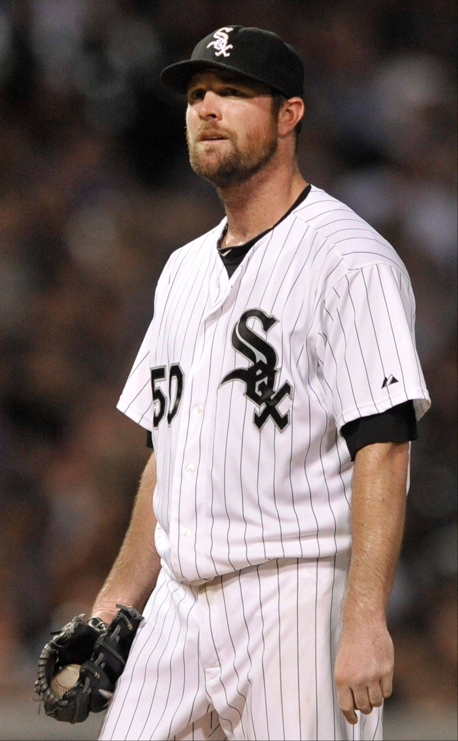 White Sox starter John Danks reacts to giving up a three-run home run to the Atlanta Braves' Brian McCann during Friday's sixth inning at U.S. Cellular Field.