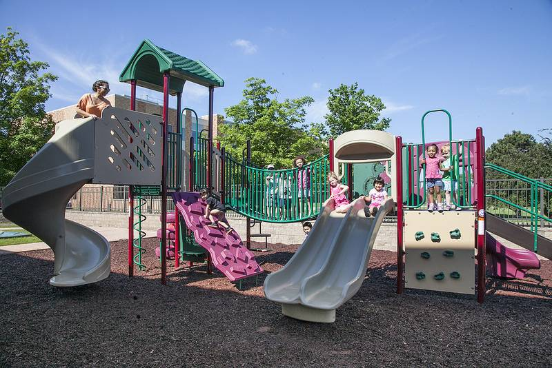 Kids enjoy the new playground equipment at the CLC Children's Learning Center on the Grayslake campus.