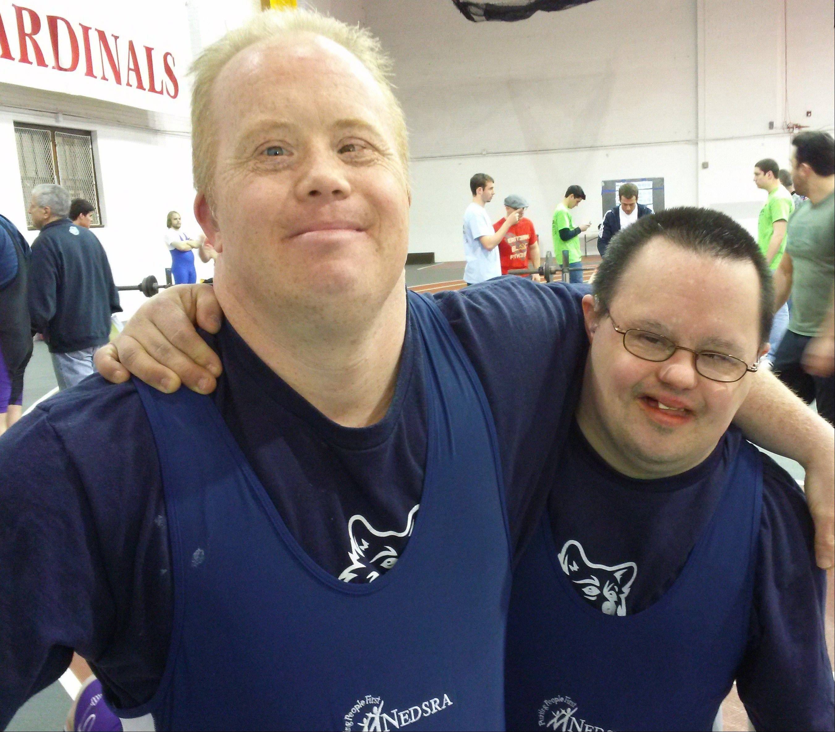 Ted Callahan, left, of Lombard with workout buddy Ray Strzewski of Roselle, competes in Special Olympics weightlifting events.