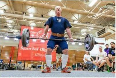 NEDSRA participant Ted Callahan competes in the dead lift at the Illinois Special Olympics Summer Games. He earned a silver medal in the event.