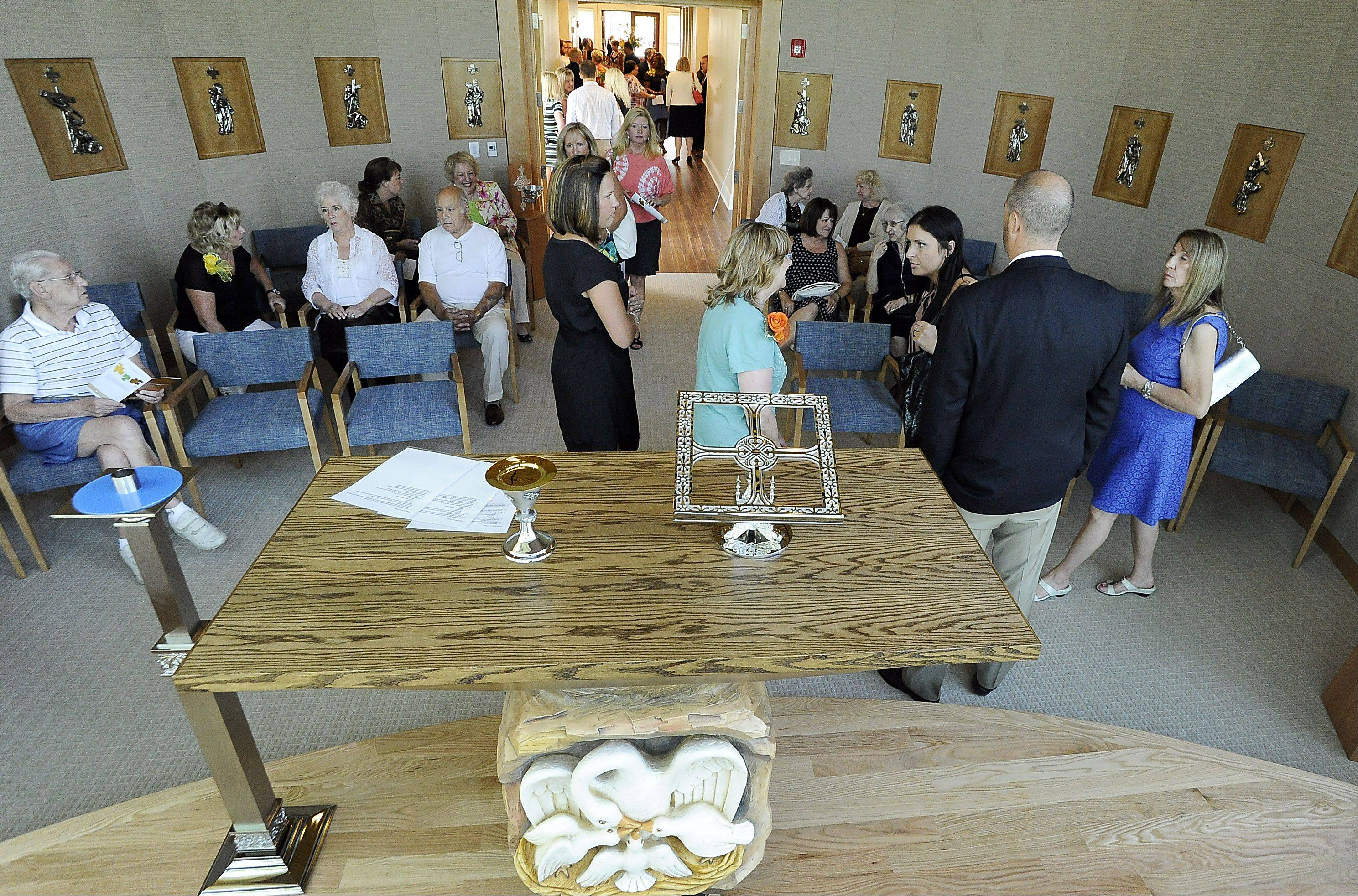 A large gathering of people checks out the new chapel Friday at the Alexian Brothers Hospice Residence in Elk Grove.