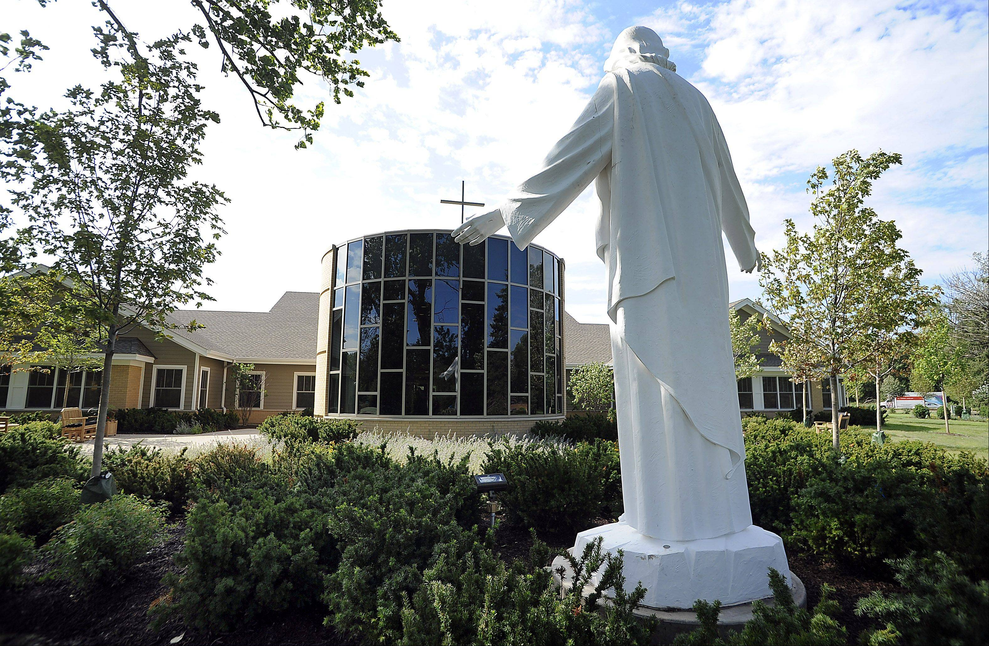 A large statue of Jesus carved in the Philippines stands over the new chapel at the Alexian Brothers Hospice Residence in Elk Grove on Friday.