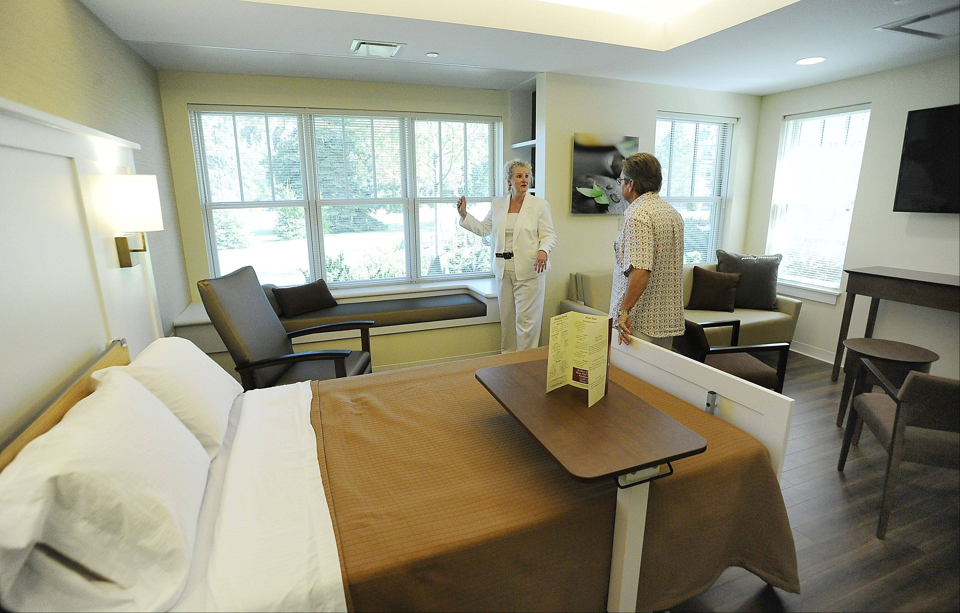 Joan Scheffler, assistant vice president of the Alexian Brothers Foundation shows off the new rooms at the Alexian Brothers Hospice Residence grand opening in Elk Grove on Friday.