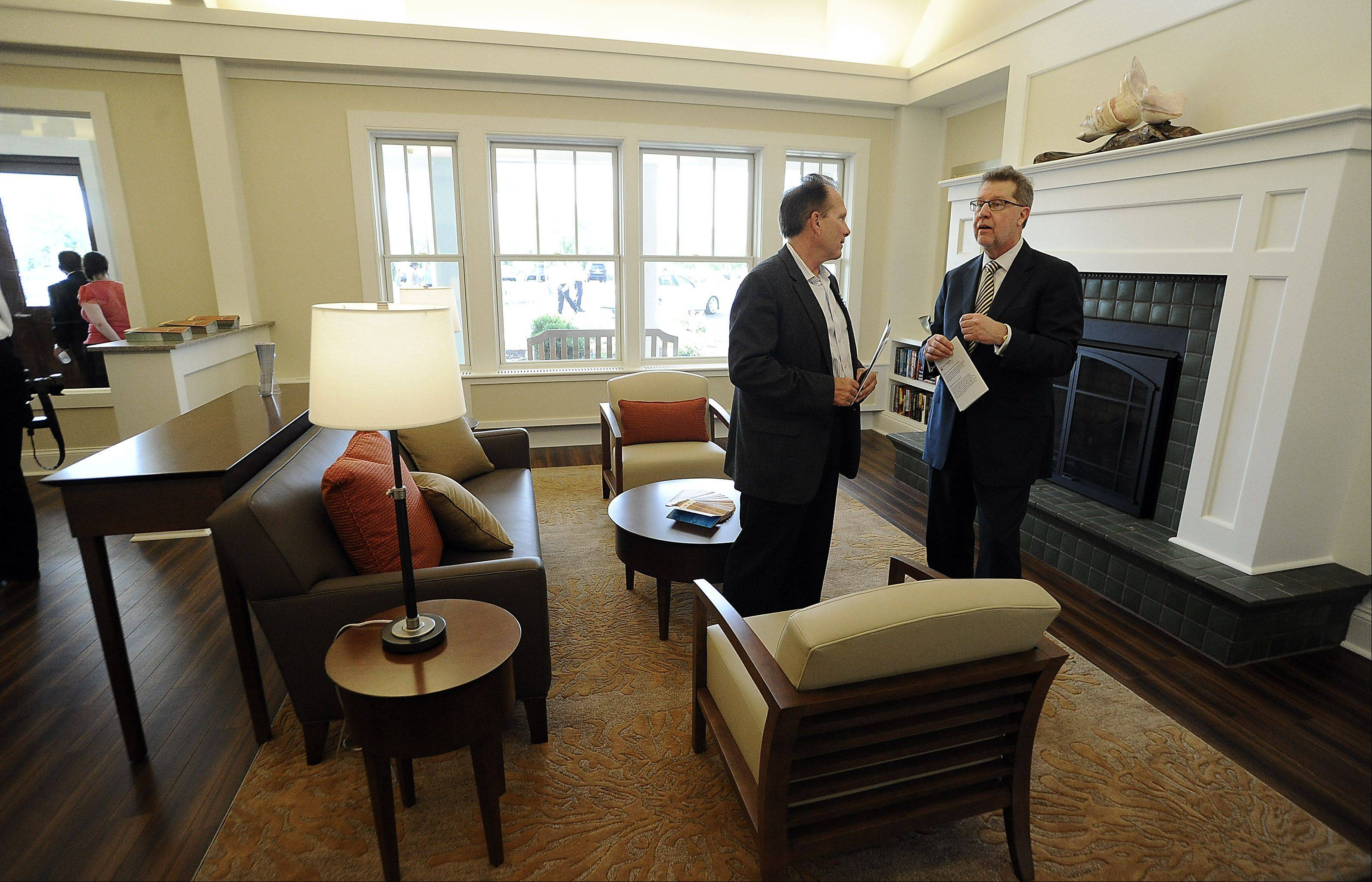 Mark Frey, president and CEO of Alexian Health System, right, and John Werrnach, president and CEO of Alexian medical center talk at the Alexian Brothers Hospice Residence grand opening in Elk Grove on Friday.