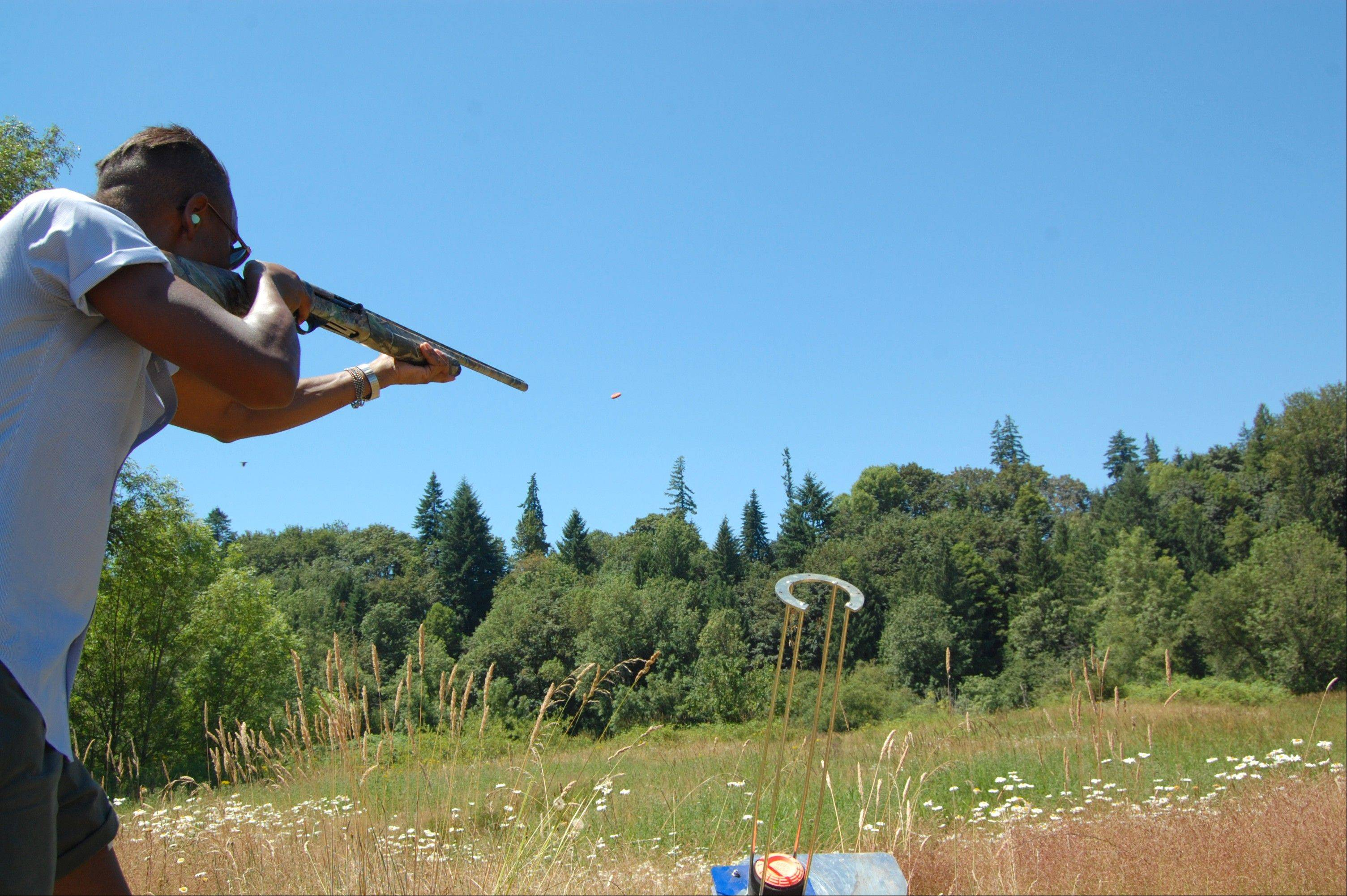 Chef Gregory Gourdet of Portland, Ore., restaurant Departure, fires a .20-gauge shotgun during firearms training near Canby, Ore. Recently, some of Portland's top chefs received training in the use of shotguns, muzzleloaders and archery gear at a 30-acre farm owned by Nicky USA, which sells and butchers game animals raised on the farm for chefs across the country.