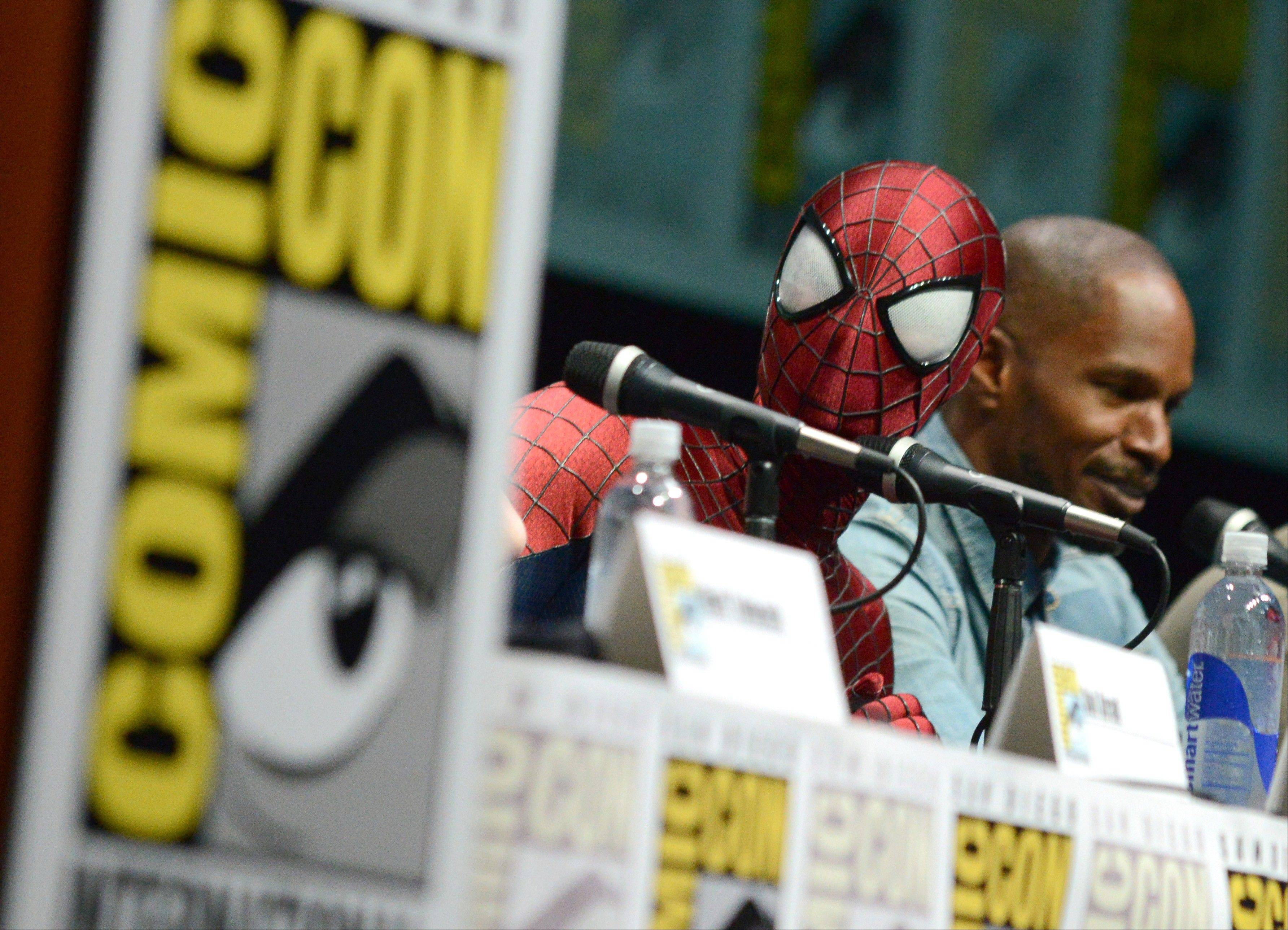"Spider-Man, left, and Jamie Foxx attend the ""The Amazing Spider-Man 2"" panel on Day 3 of Comic-Con International on Friday."