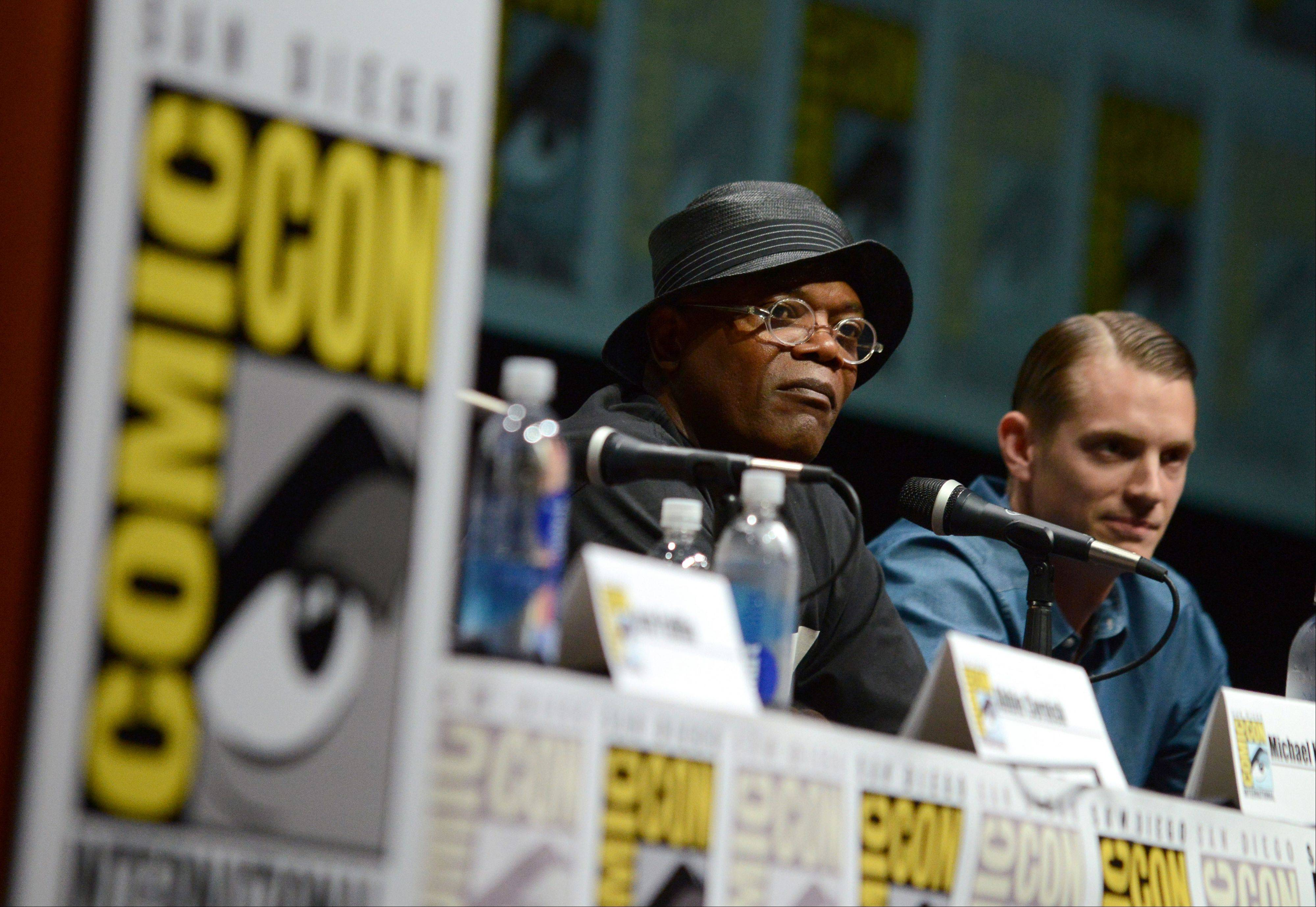 "Samuel L. Jackson, left, and Joel Kinnaman attend the ""RoboCop"" panel on Day 3 of Comic-Con International on Friday."