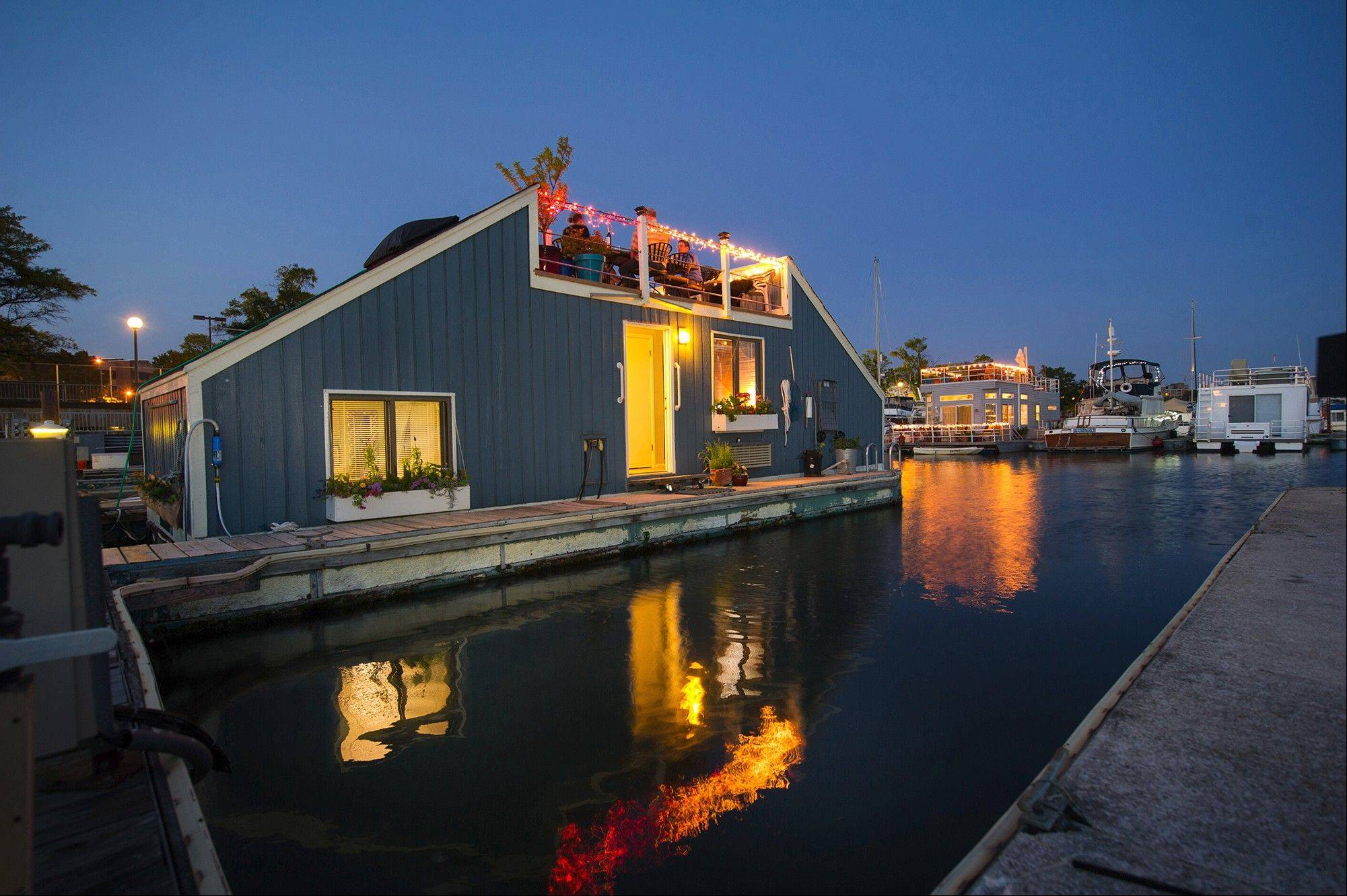 Karen Anderson's houseboat, Serendipity 2, at Gangplank Marina in Washington. The Serendipity, a barge that looks like an A-frame with the top lopped off, has less than 500 square feet.