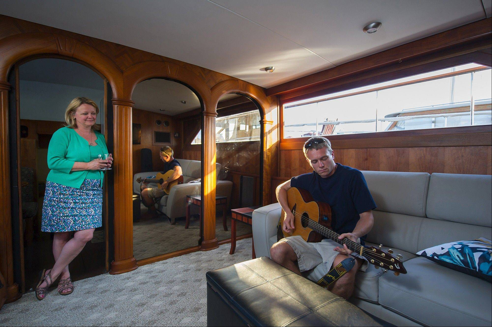Tonya Nichols, with son Matt aboard Golden Princess, the family's 1,300-square-foot, 60-foot-long houseboat.