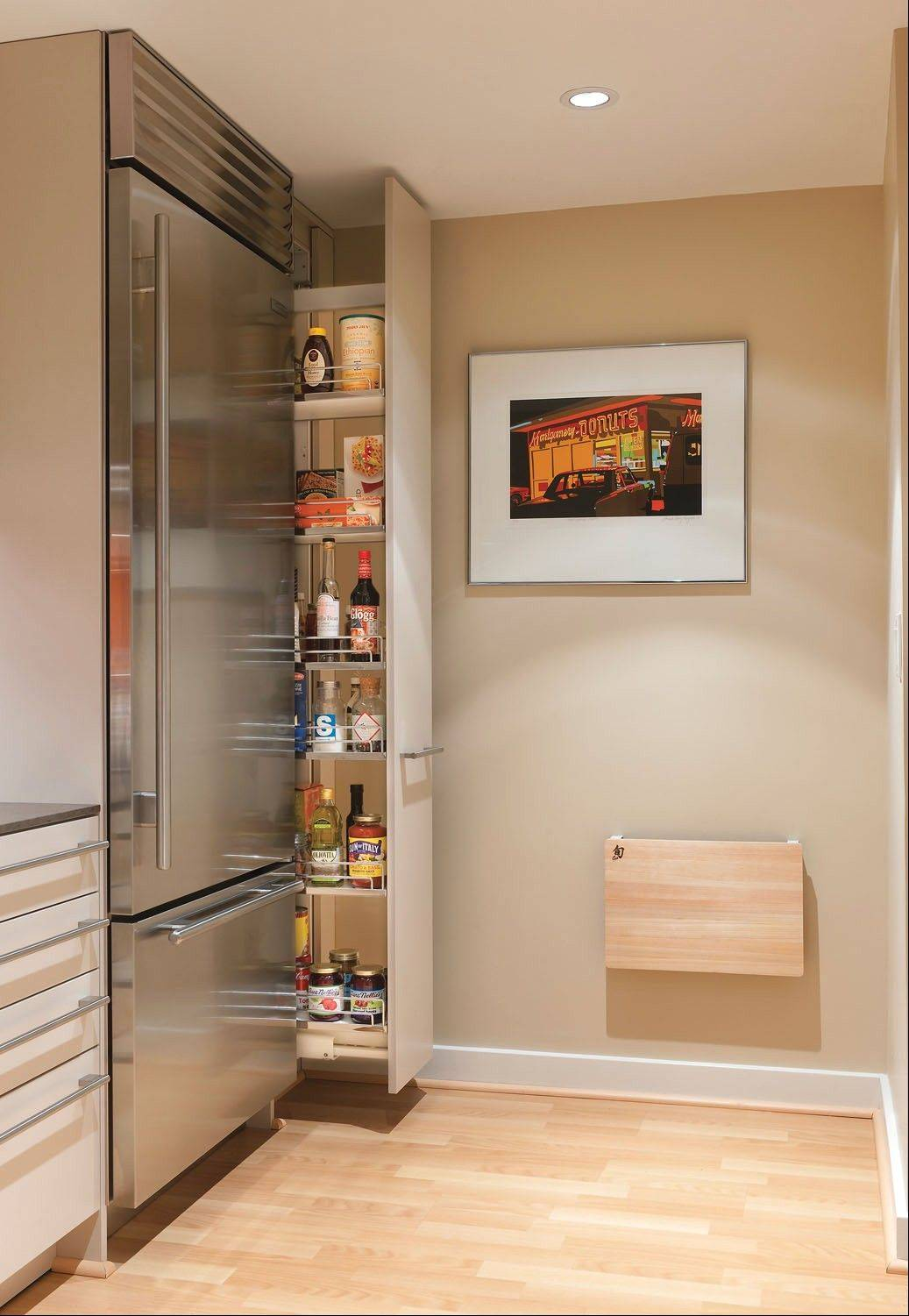 Drawers and pullout pantries, like the one at right, make the most of awkward spaces. They allow easy access to the back of the storage area.