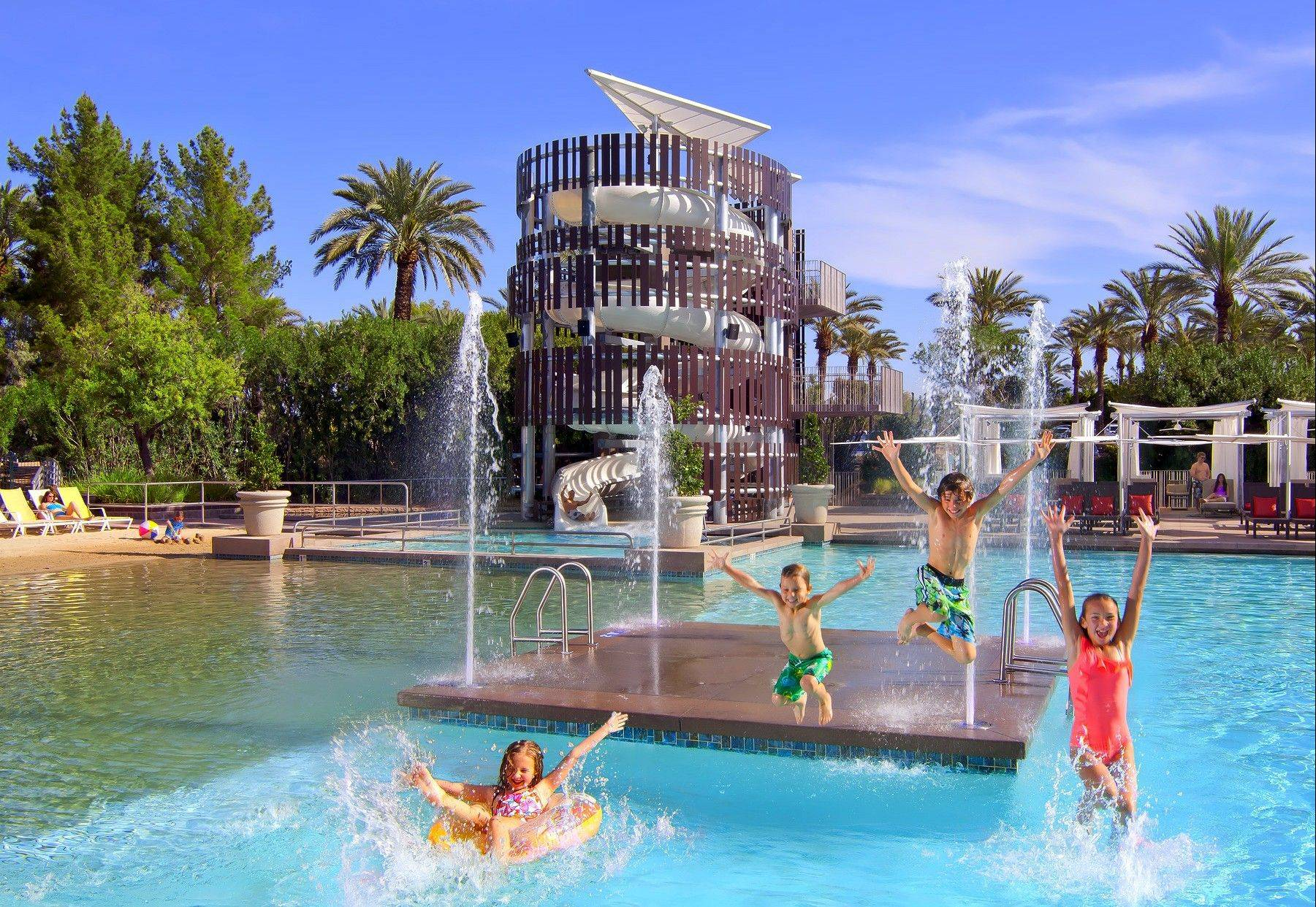 Children enjoy themselves in the pool of the Hyatt Regency Scottsdale Resort & Spa in Scottsdale.