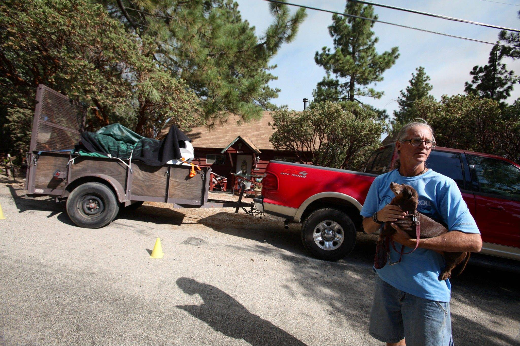 Pine Cove, Calif., resident Mark Dean and his dog Candy are packed and ready Friday if mandatory evacuation is announced.