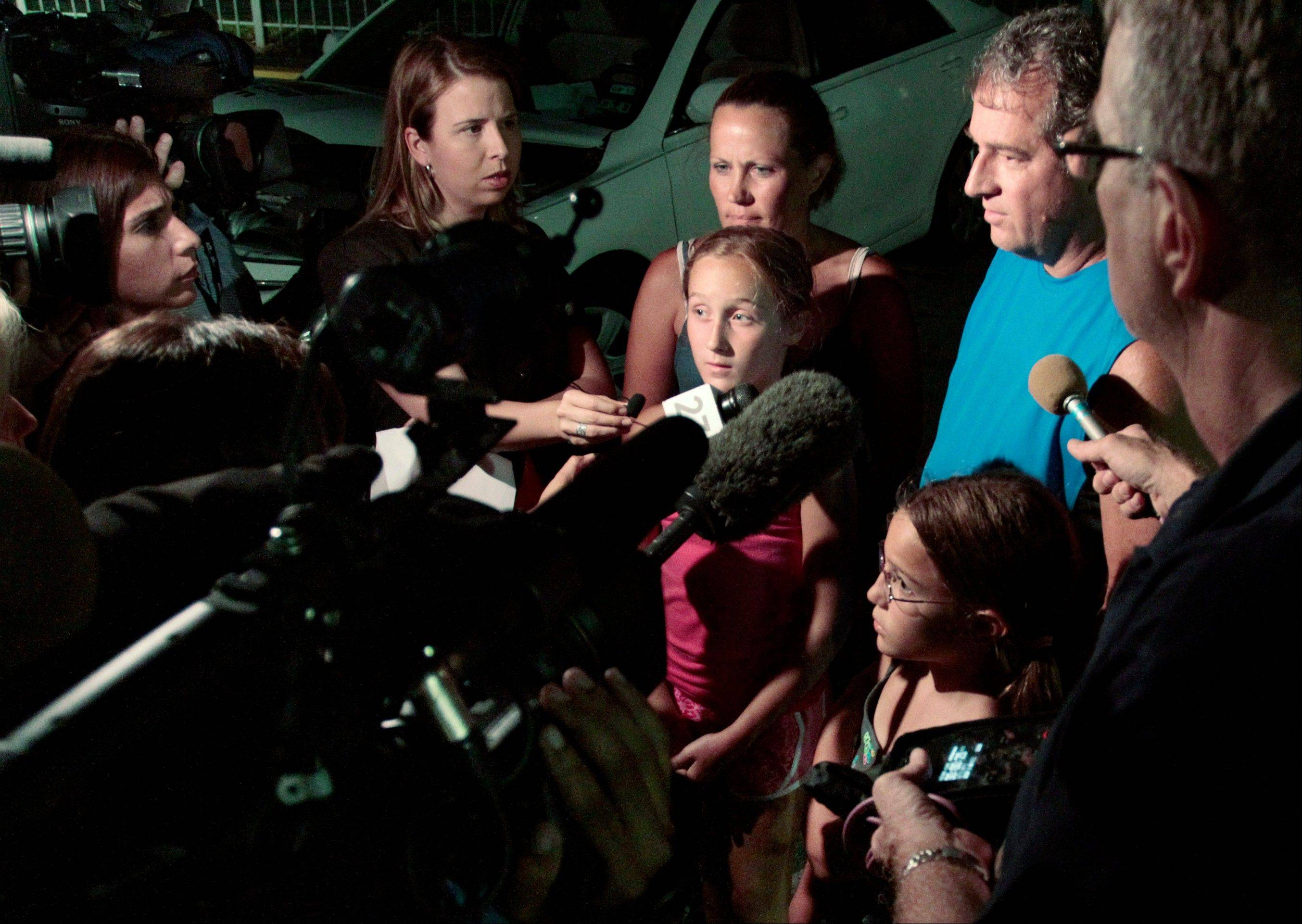 Associated PressMembers of the Putnam family, who were present when a woman died after falling from a roller coaster, are interviewed by reporters at Six Flags Over Texas in Arlington, Texas.