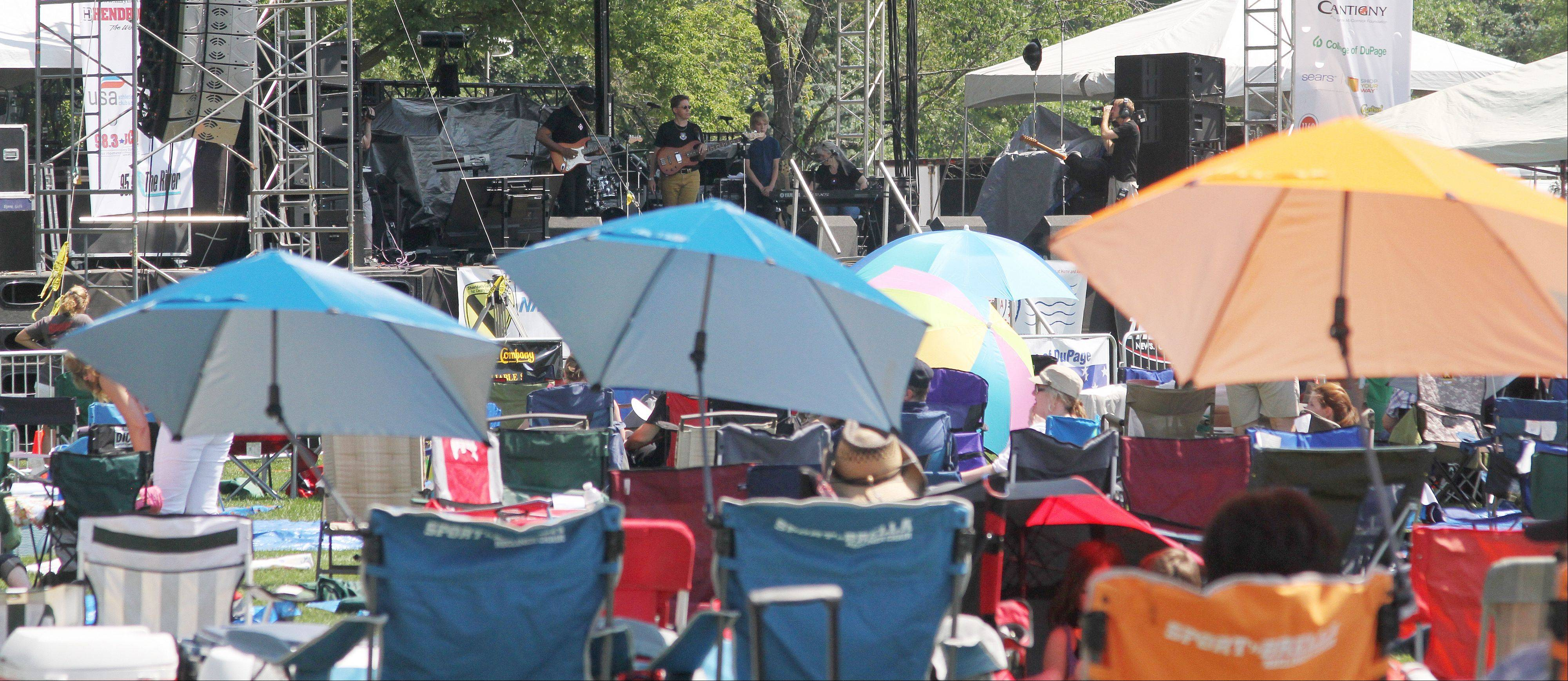 People set up lawn chairs and umbrellas on Saturday at Cantigny Park in Wheaton for the annual Rockin' for the Troops concert.