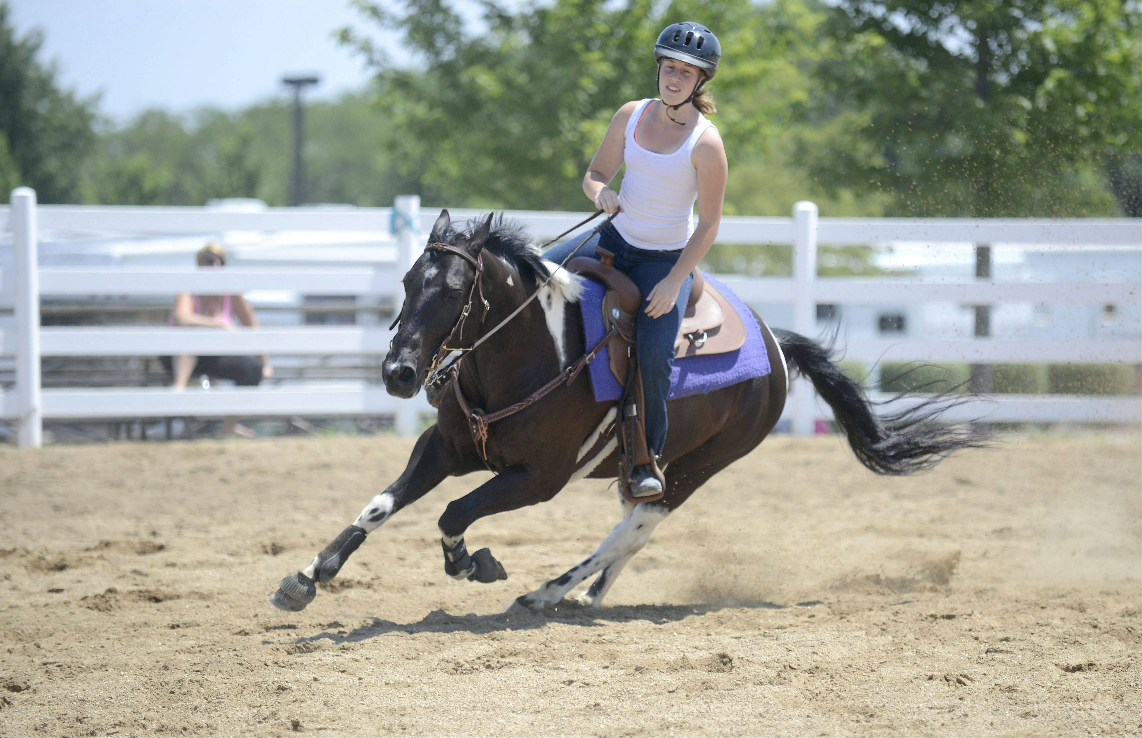 Hannah Wallace, 16, of Sugar Grove, exercises her horse, Jimmy, 9, on Saturday at the Kane County Fair in St. Charles. Wallace is a member of the Y-Not 4-H club out of Maple Park. She has been riding for three years and competed the last two years at the fair.
