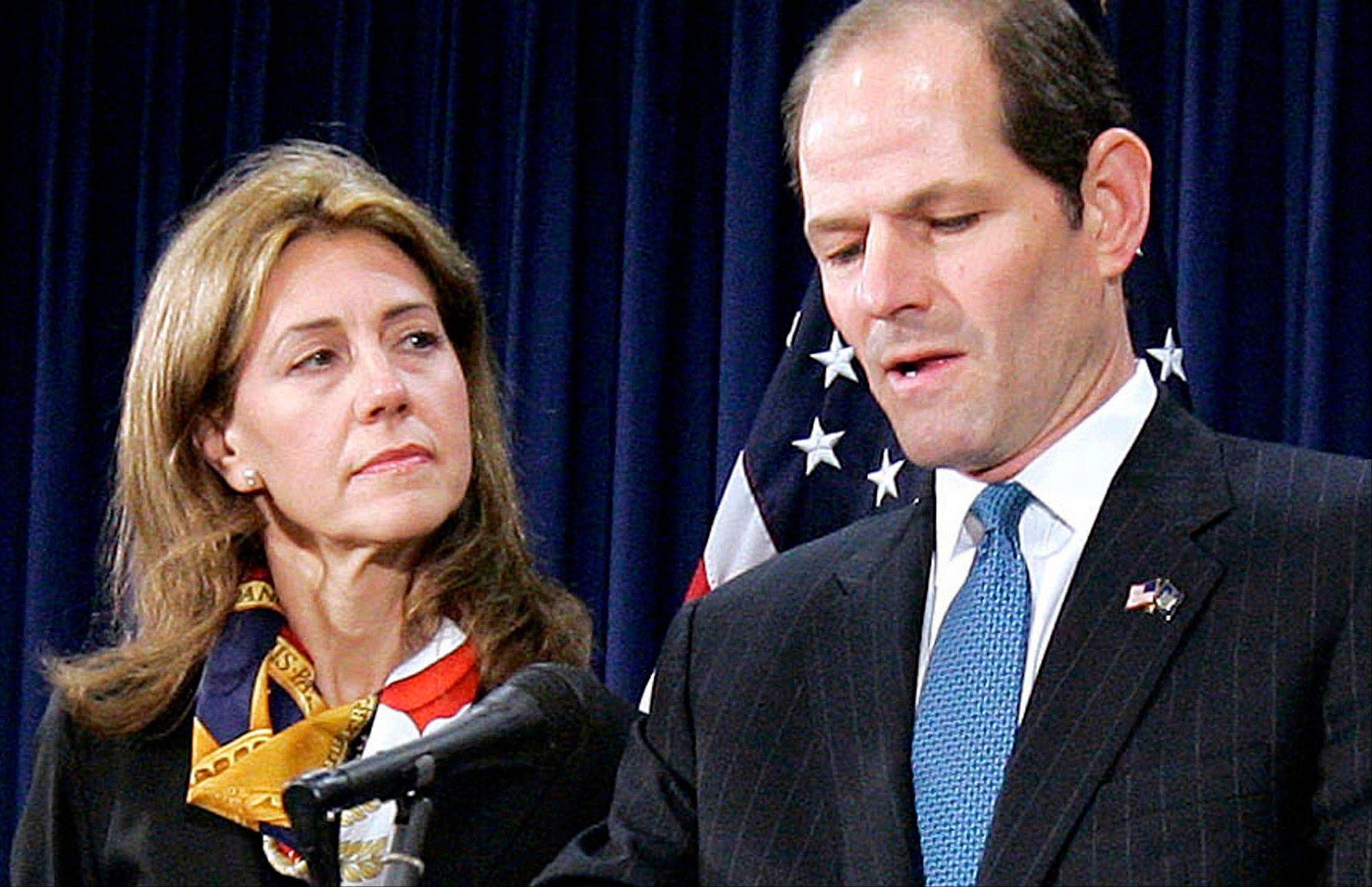 Associated Press/March 12, 2008New York Gov. Eliot Spitzer announces his resignation amid a prostitution scandal as his wife Silda stands by at the governor's office in New York.