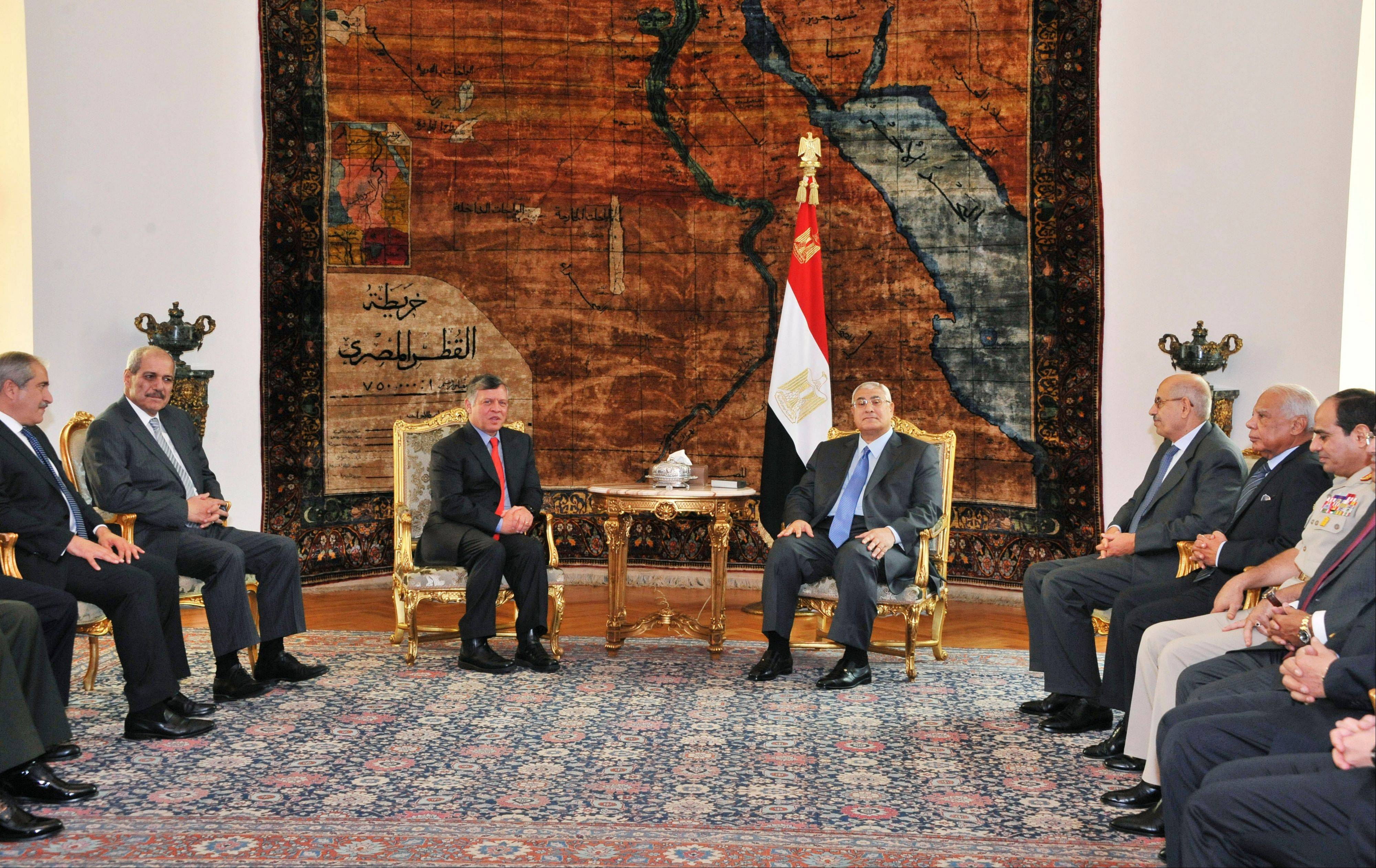 Associated PressIn this image released by the Egyptian presidency, Egypt's President Adly Mansour, center right, meets Jordan's King Abdullah II, center left, at the presidential palace in Cairo, Egypt, Saturday, July 20. Jordan's King Abdullah II arrived in Egypt's capital on Saturday for a short visit -- the first visit by a head of state to Egypt since the ouster of President Mohamed Morsi on July 3. Jordan's Foreign Minister Nasser Judeh, from left, Chief of the Jordanian Royal Court Fayez Tarawneh, Vice President Mohammed ElBaradei, Prime Minister Hazem el-Beblawi and Defense Minister Gen. Abdel-Fattah el-Sissi also joined the meeting.
