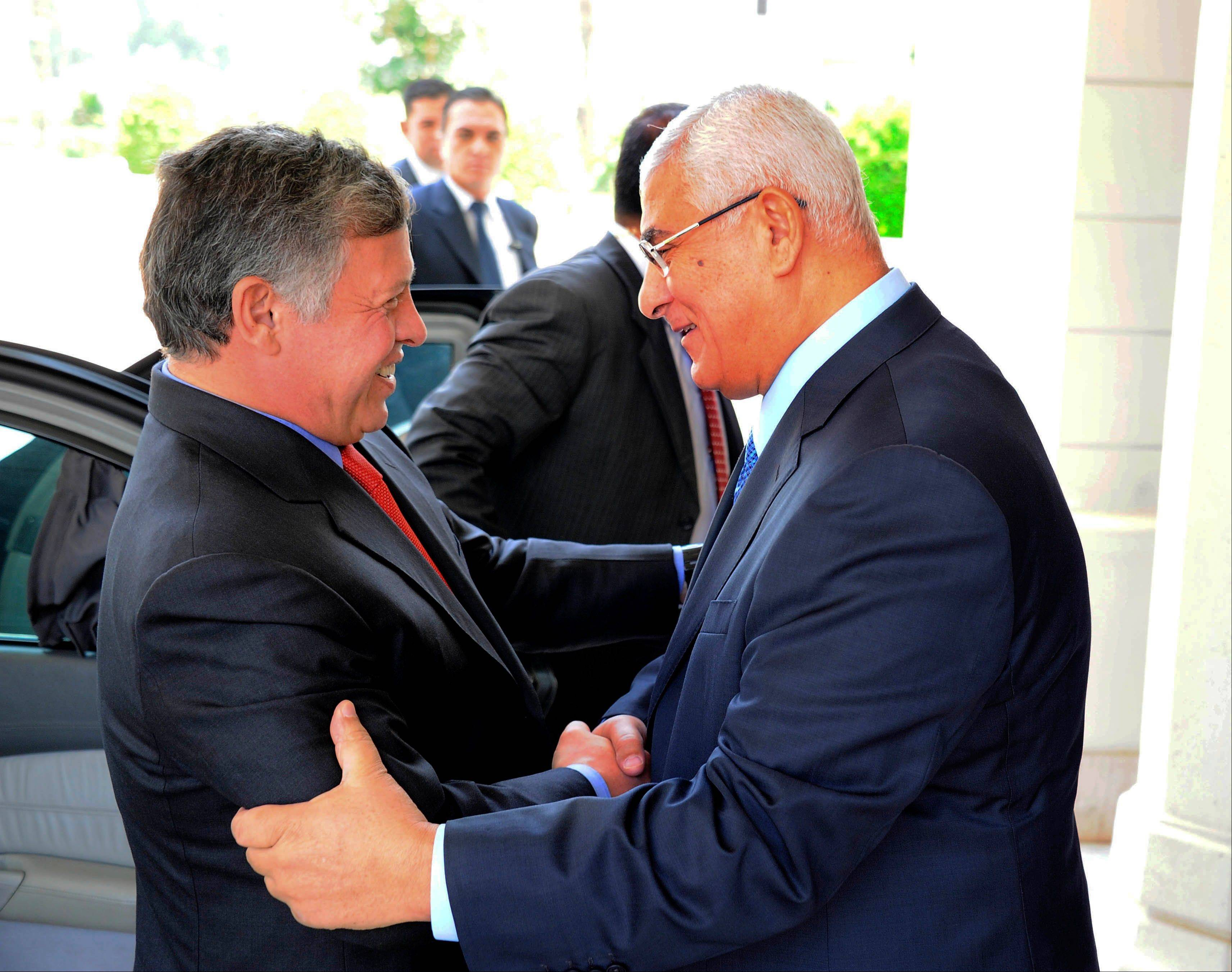 Associated PressIn this image released by the Egyptian presidency, Egyptian President Adly Mansour, right, greets Jordan's King Abdullah II on his arrival to the presidential palace, Saturday, July 20. Jordan's King arrived in Egypt's capital on Saturday for a short visit -- the first visit by a head of state to Egypt since the ouster of President Mohamed Morsi on July 3.