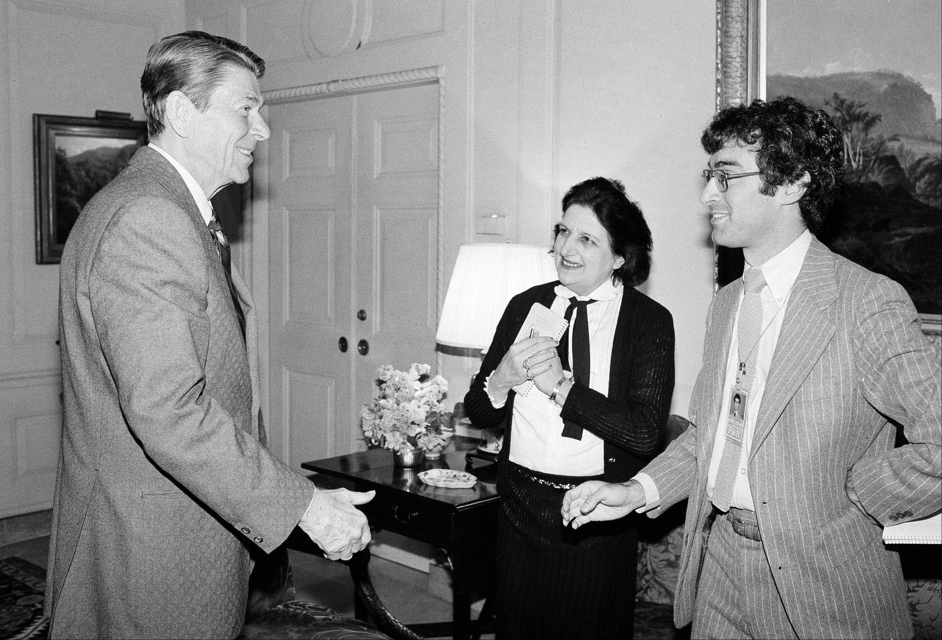 Associated PressIn this April 13, 1981, file photo, President Ronald Reagan greets UPI reporter Helen Thomas, center, and AP reporter Jim Gerstenzang, right, before an interview in the Treaty Room of the White House in Washington. Thomas, a pioneer for women in journalism and an irrepressible White House correspondent, has died Saturday, July 20. She was 92.