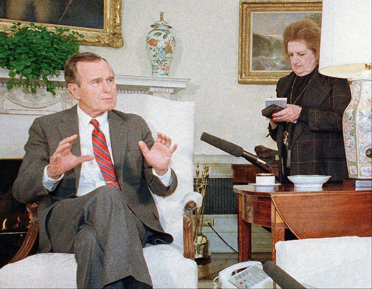 Associated Press In this Jan. 21, 1989, file photo, President George H. Bush speaks with reporters, including Helen Thomas, right, in Washington. Thomas, a pioneer for women in journalism and an irrepressible White House correspondent, has died Saturday, July 20. She was 92.