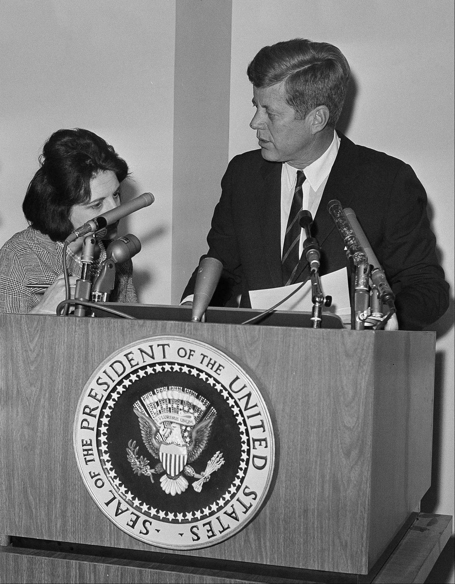 Associated PressIn this May 12, 1963, file photo, reporter Helen Thomas asks President John F. Kennedy for copies of his announcement pledging Federal power to preserve order and lives in Birmingham, Ala., during a news conference at the White House in Washington. Thomas, a pioneer for women in journalism and an irrepressible White House correspondent, has died Saturday, July 20. She was 92.