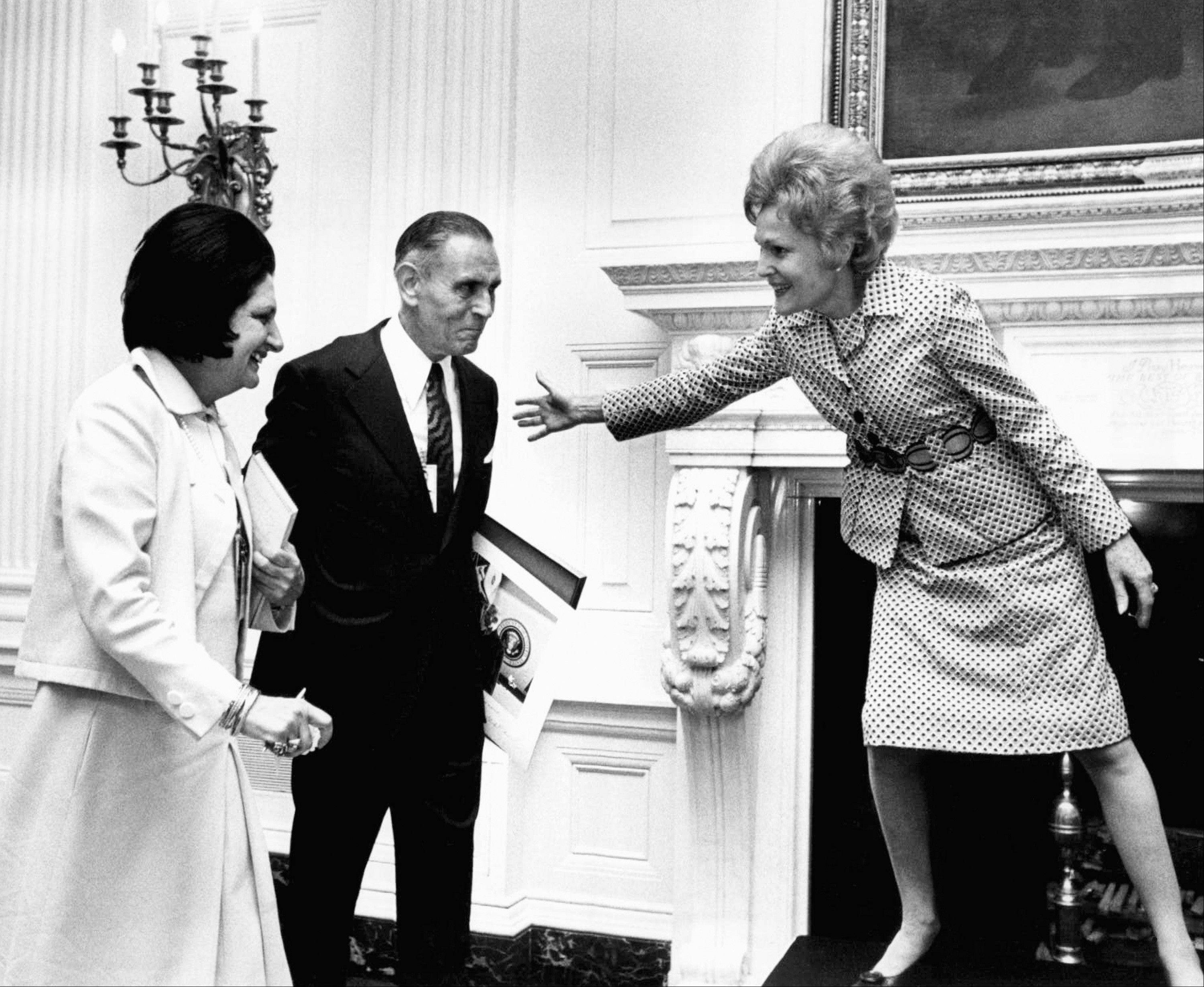 Associated PressIn this Oct. 1, 1971, file photo first lady Pat Nixon motions to Helen Thomas, left, and Douglas B. Cornell to join her on a platform at a White House reception. Thomas, the irrepressible White House correspondent who scooped so many, was herself scooped by the first lady who announced their engagement near the end of the impromptu reception. Thomas, who used her seat in the front row of history to grill nine presidents and was not shy about sharing her opinions, died Saturday, July 20. She was 92.