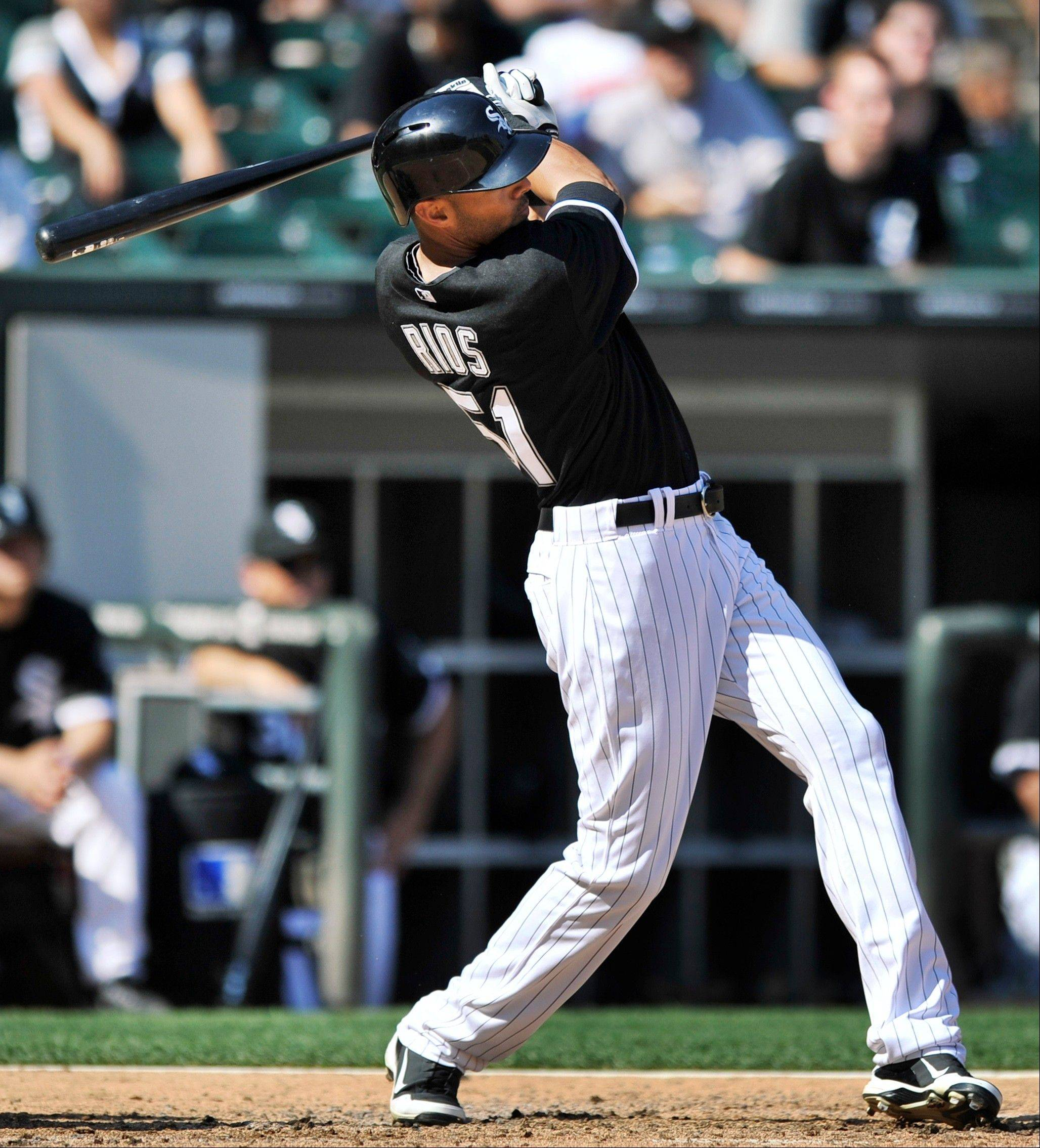 The White Sox' Alex Rios watches his grand slam sail to the seats in the third inning Saturday against the Braves.