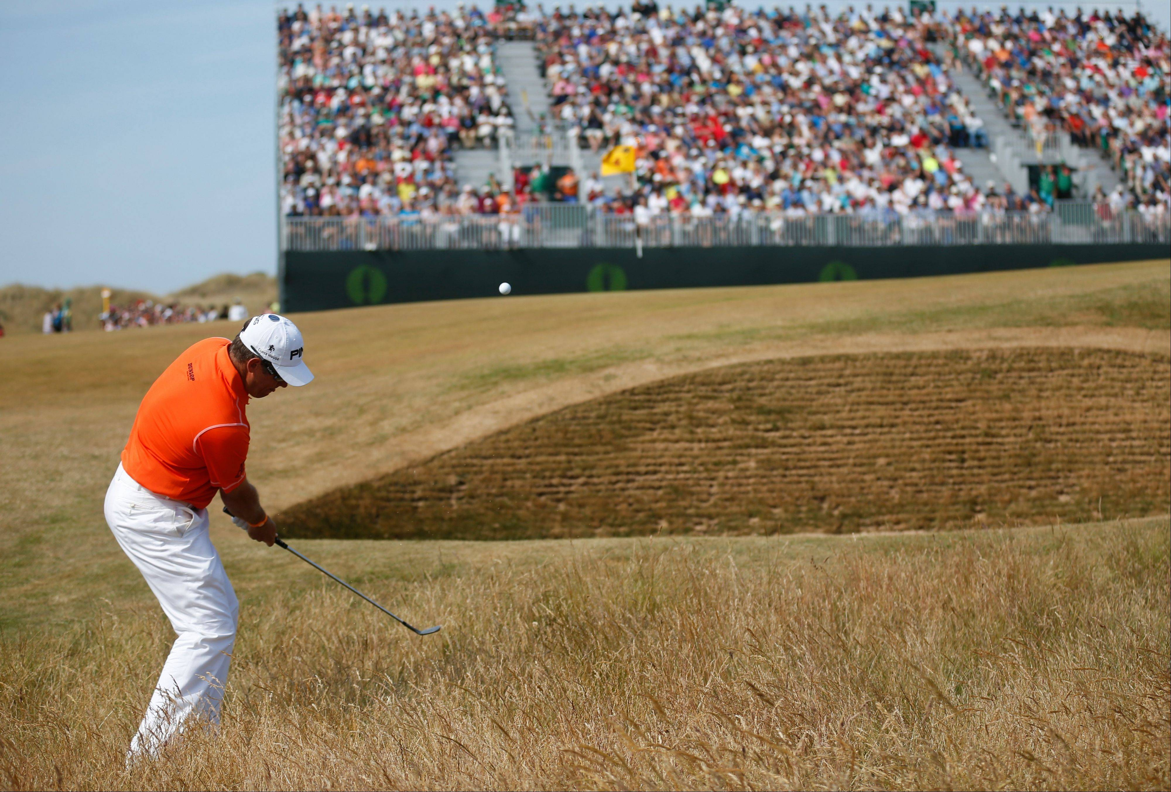 Lee Westwood of England plays a shot on the 4th hole during the third round of the British Open Golf Championship at Muirfield, Scotland.