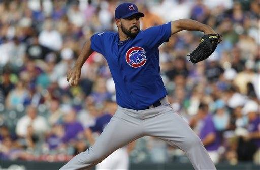 Chicago Cubs starting pitcher Carlos Villanueva works against the Colorado Rockies in the first inning of a baseball game in Denver on Saturday in Denver. Villanueva has lost both of his starts against the Rockies.