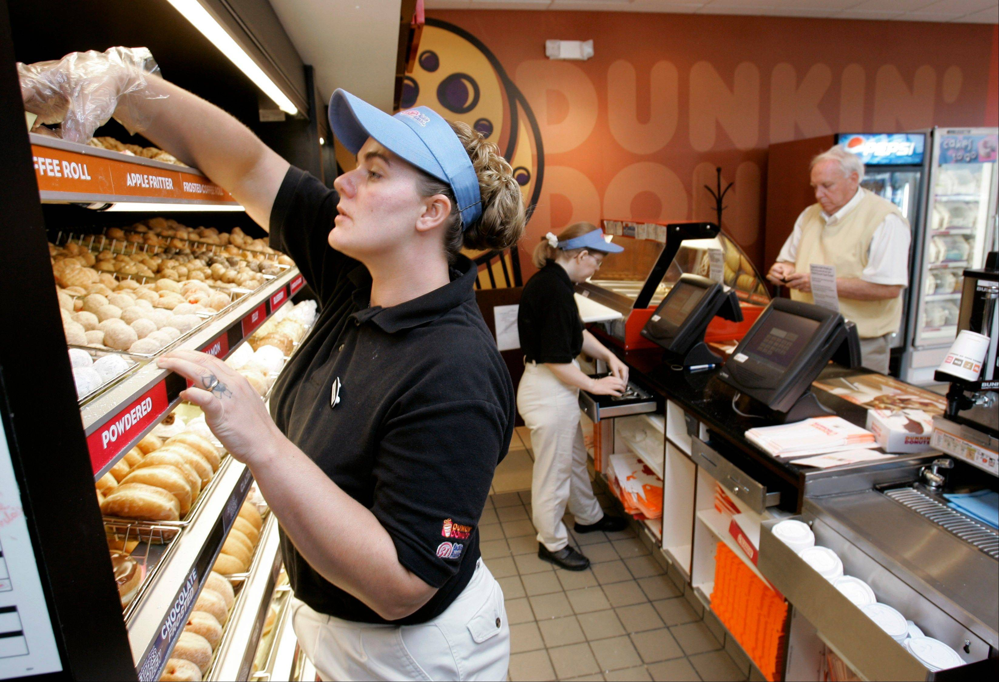Frankie Morris, left, fills a costumer�s order at the Dunkin� Donuts store, in Franklin, Tenn. Dunkin� Donuts offers seniors who purchase a large or extra-large beverage a free doughnut, but you have to show your AARP card.
