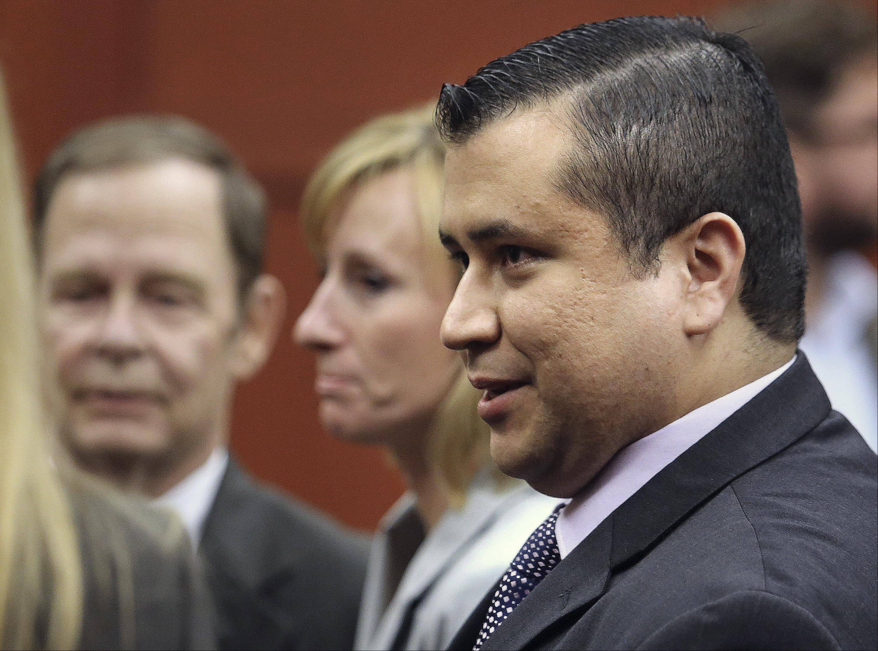 George Zimmerman leaves court with his family after the verdict was announced July 13. (AP Photo)