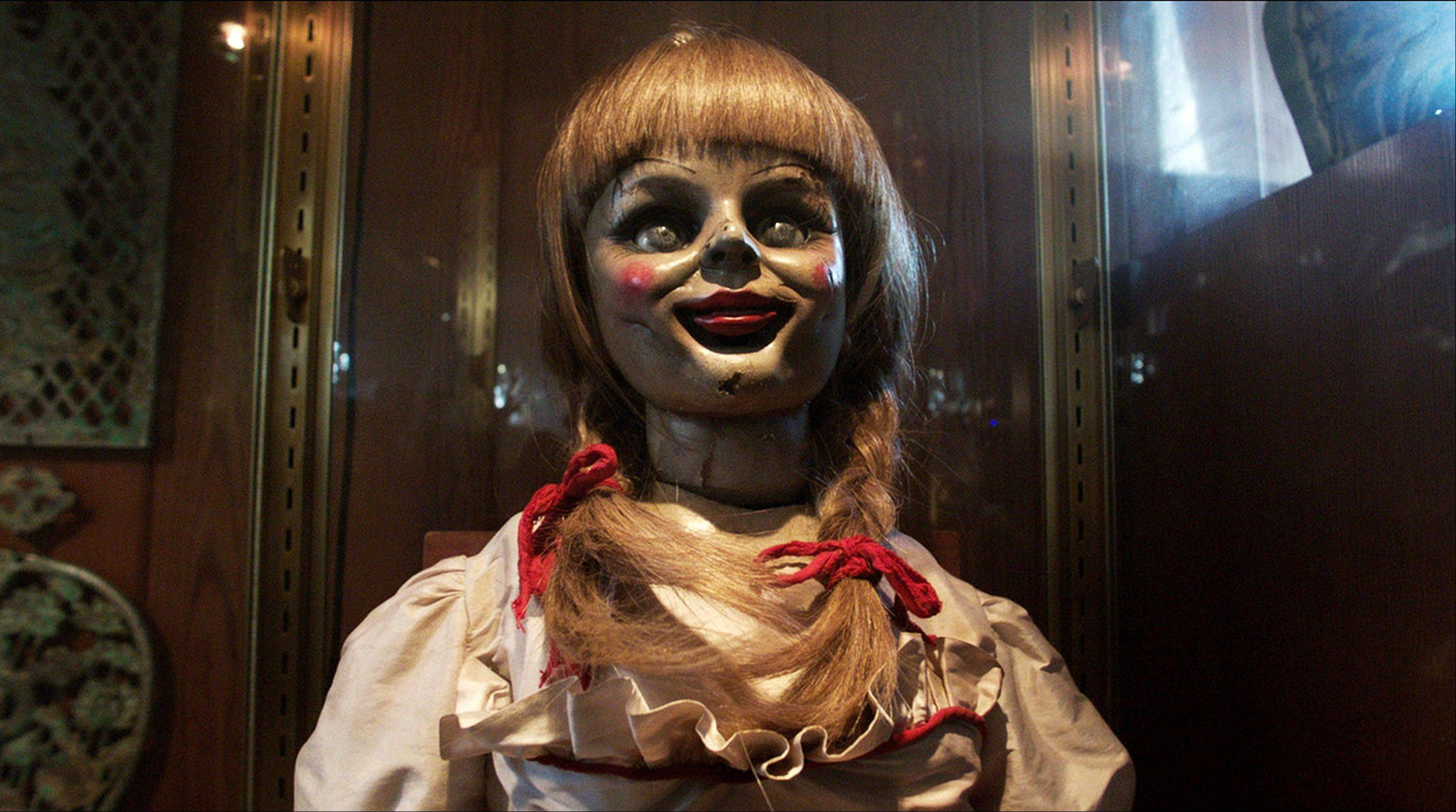 "This film publicity image released by Warner Bros. shows the demonically possessed doll that opens James Wan's horror movie ""The Conjuring,"" which made more than $40 million in its first weekend of release."