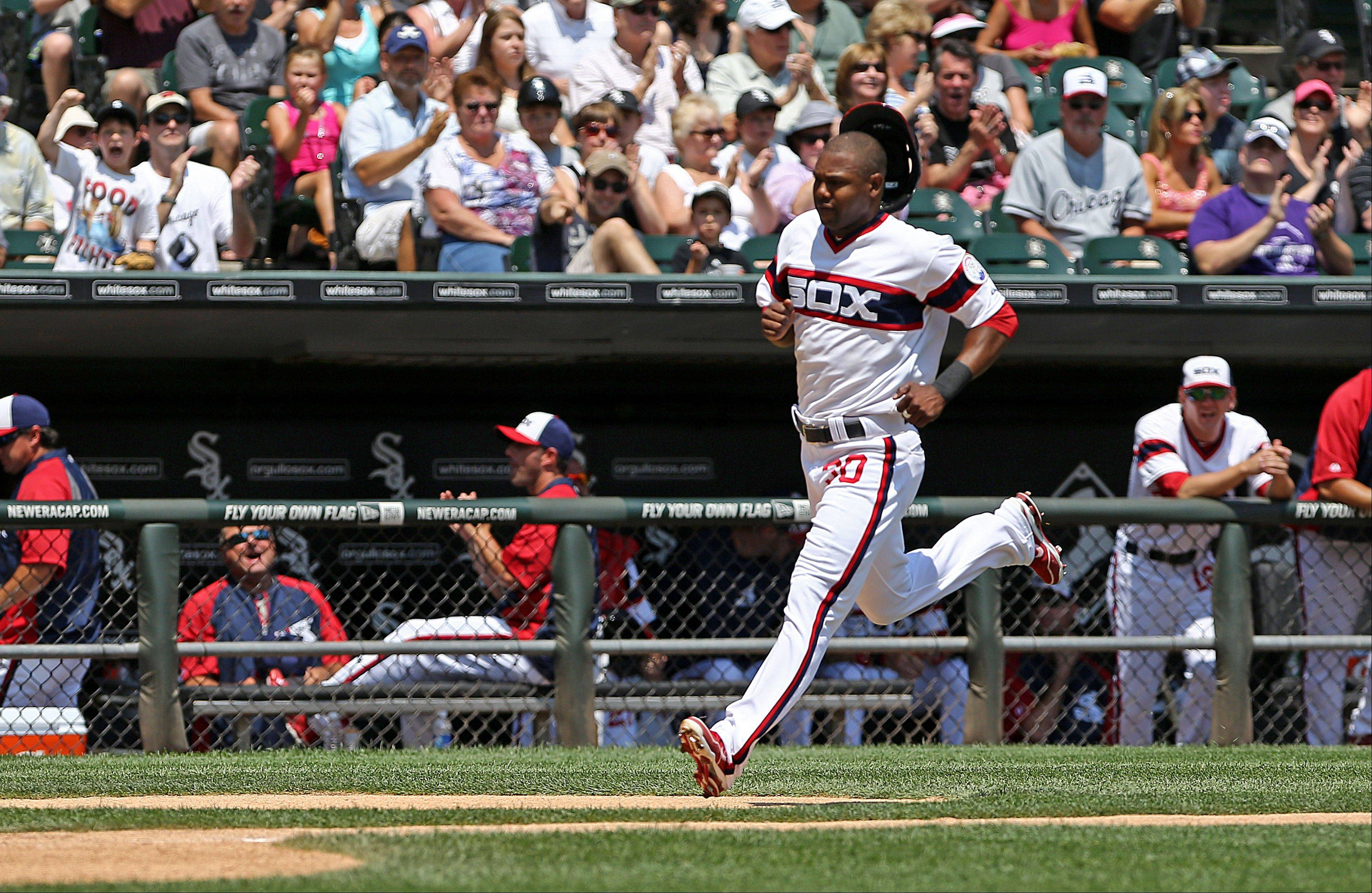 White Sox outfielder Alejandro De Aza scores in Sunday�s first inning against the Atlanta Braves at U.S. Cellular Field.