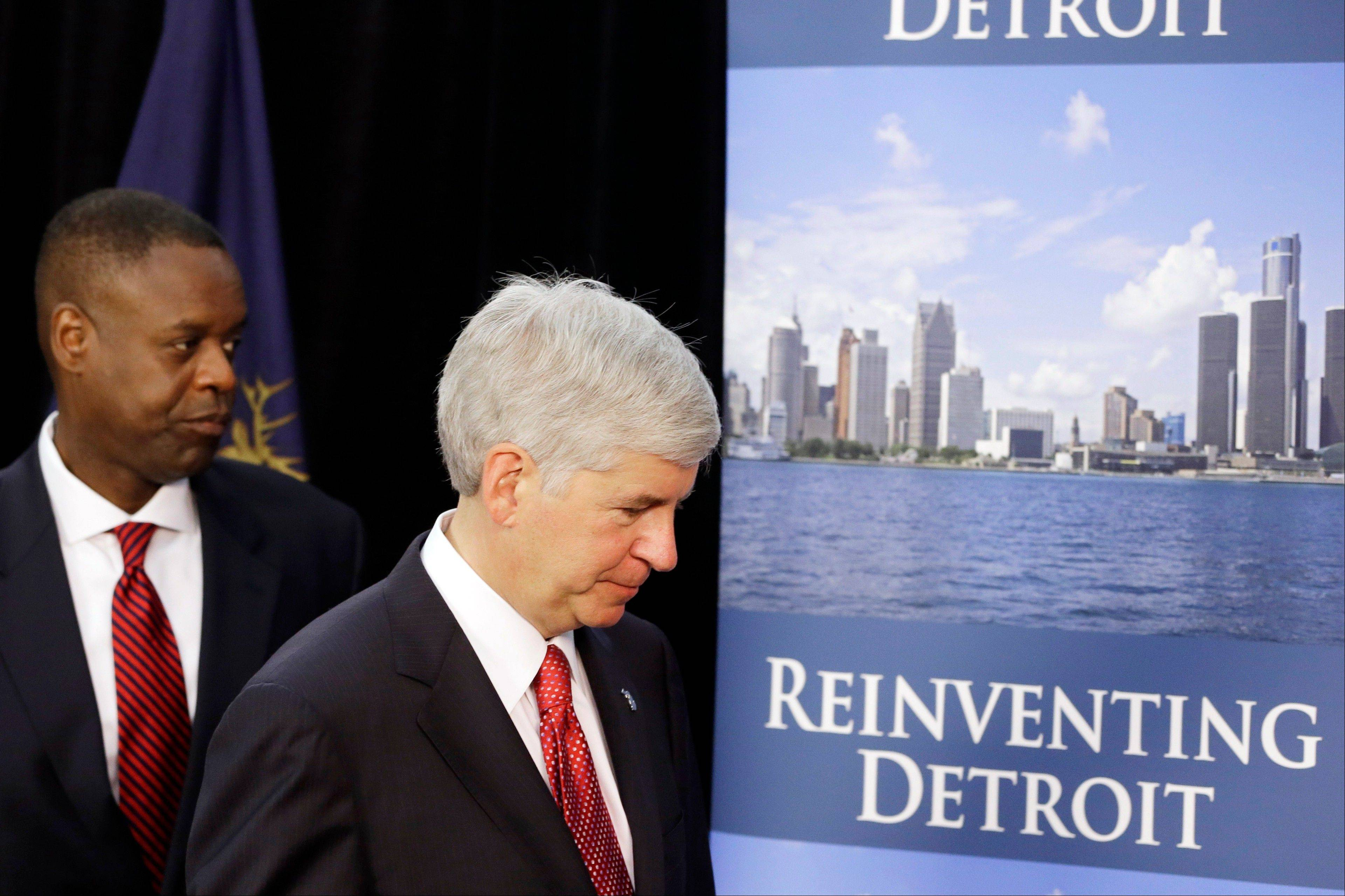 Michigan Gov. Rick Snyder, right, and state-appointed emergency manager Kevyn Orr leave a news conference in Detroit Friday after addressing the city's bankruptcy.