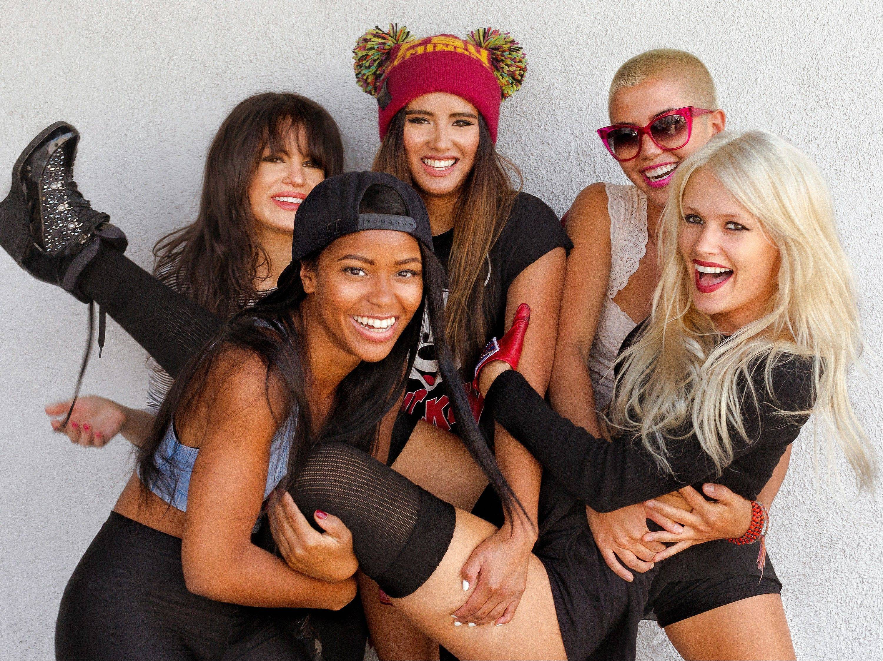 The Pussycat Dolls got a makeover as G.R.L. with Simone Battle, clockwise from foreground left, Natasha Slayton, Emmalyn Estrada, Paula Van Oppen and Lauren Bennett.