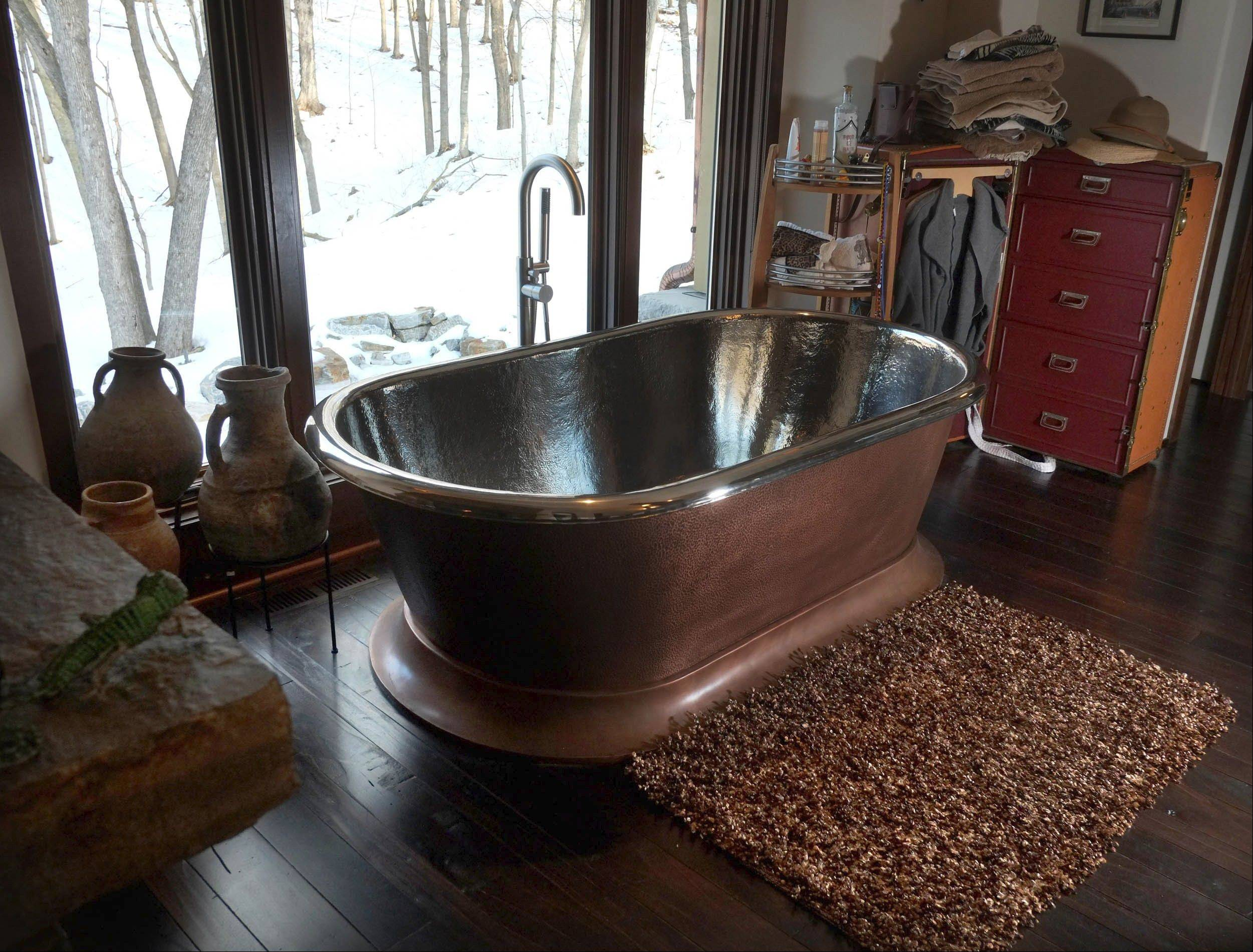 A nickel-and-copper tub is the centerpiece of the master bath.