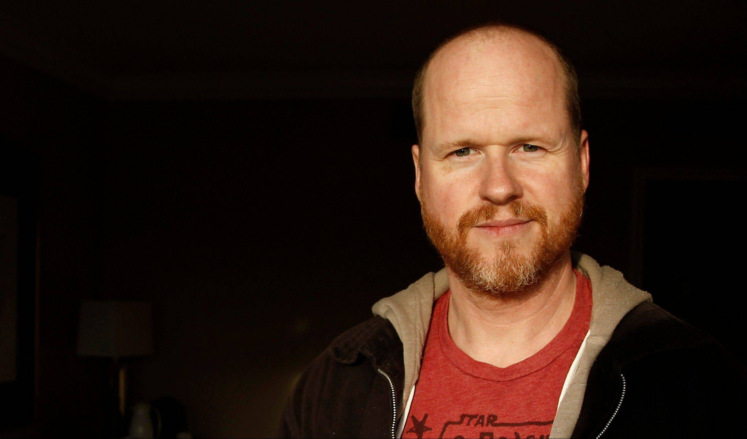 "This May 4, 2012 file photo shows writer and director, Joss Whedon, from the film ""The Avengers,"" posing for a portrait in Beverly Hills, Calif. Whedon said Sunday at Comic-Con International that the storylines of Buffy and his other Vampire Slayer title Angel & Faith will intertwine in interesting ways when Season 10 begins its published run."