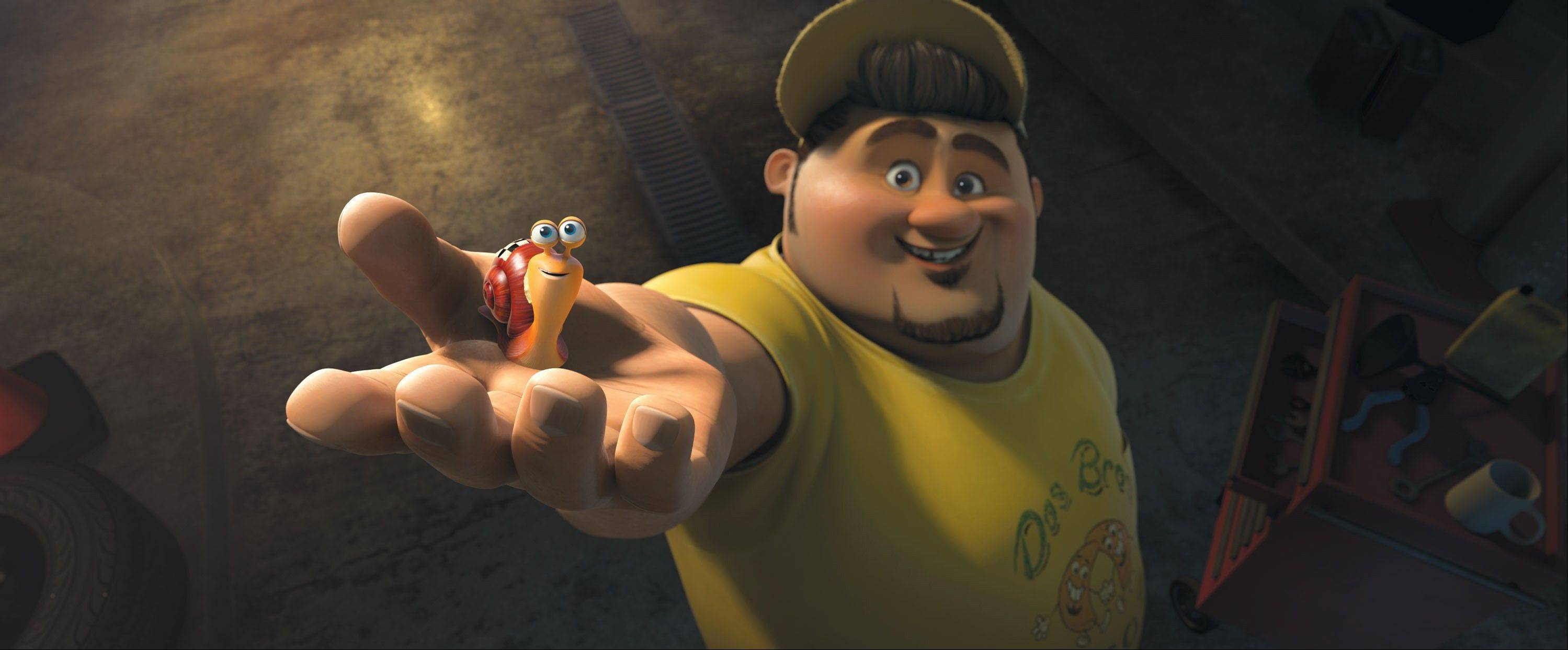 "This film publicity image released by DreamWorks Animation shows Turbo, voiced by Ryan Reynolds, left, and Tito, voiced by Michael Pena, in a scene from the animated movie ""Turbo,"" about an underdog snail whose dreams kick into overdrive when he miraculously attains the power of super-speed."