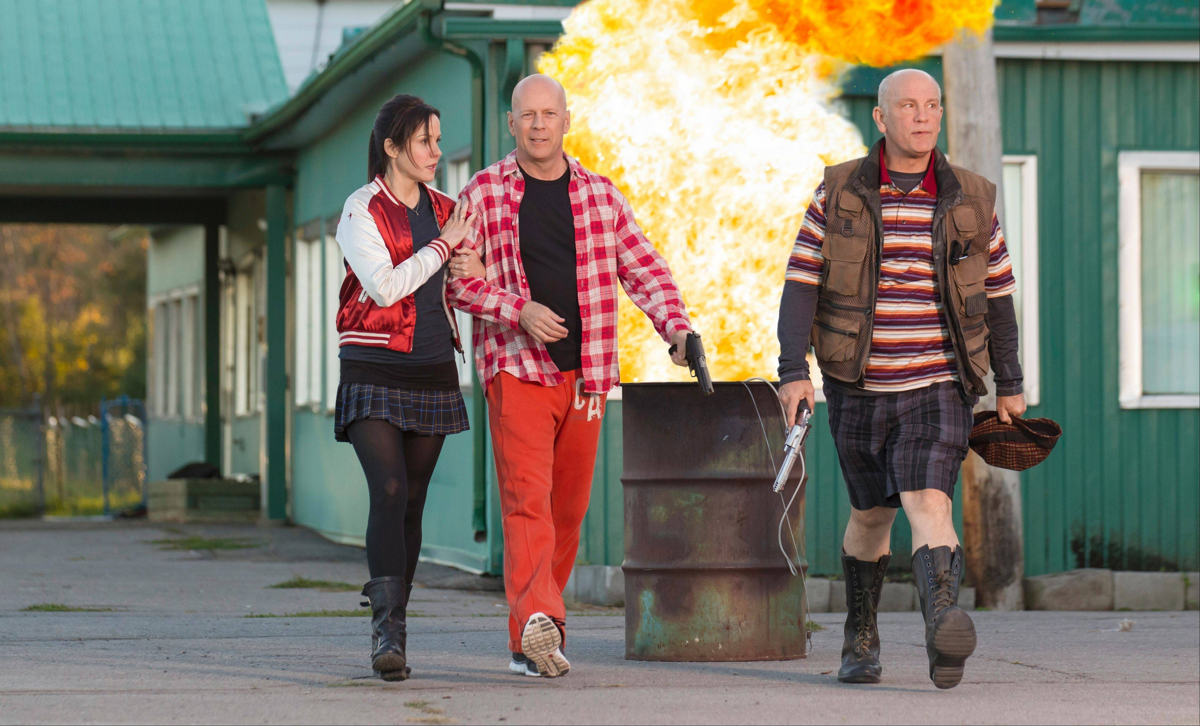 "This film publicity image released by Summit Entertainment shows Sarah (Mary-Louise Parker), Frank (Bruce Willis), center, and Marvin (John Malkovich) demonstrate their fashion flair as covert agents in the action comedy ""Red 2."""