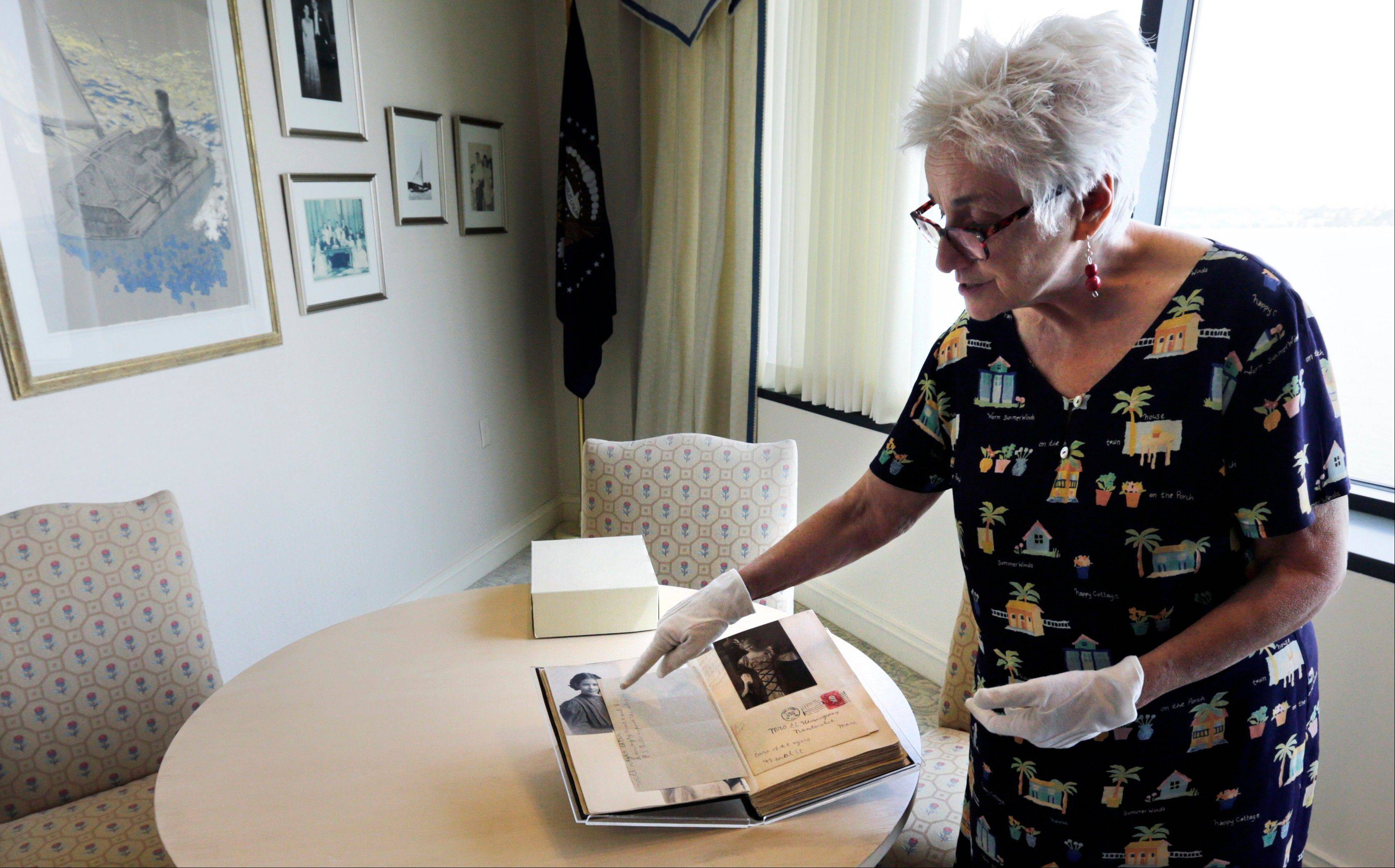 Susan Rynn, the Hemingway Collection curator, displays a scrapbook made by Ernest Hemingway's mother Grace Hall Hemingway, at the John F. Kennedy Presidential Library in Boston.