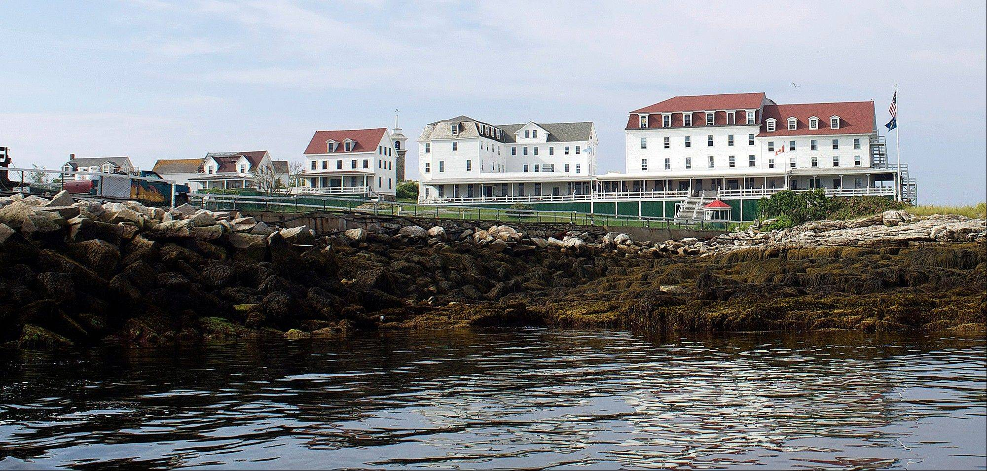 Buildings including the hotel, far right, are seen on Star Island off the New Hampshire coast in Rye, N.H.