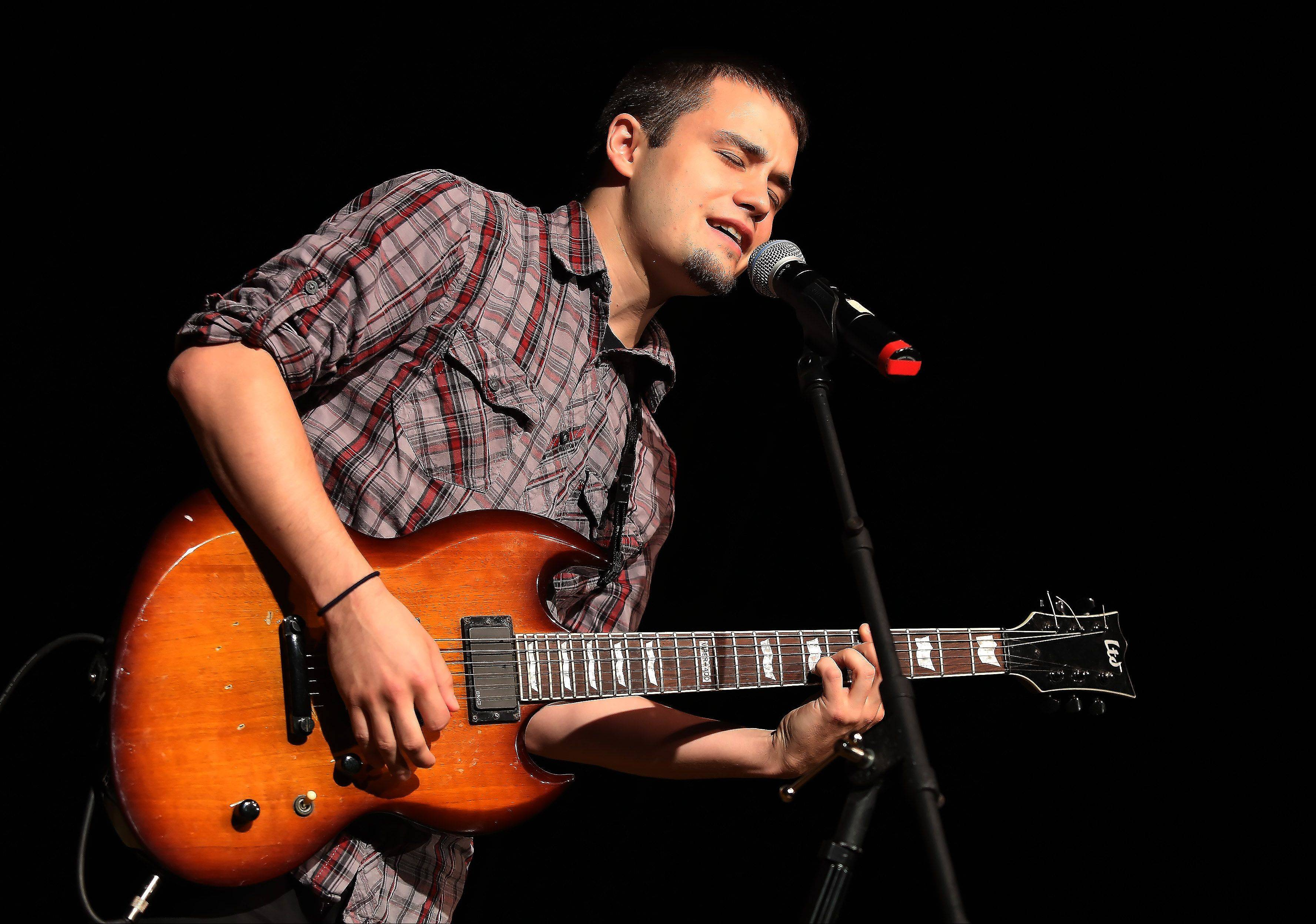 Ryan Cooper of Schaumburg plays guitar and sings during Suburban Chicago's Got Talent competition Sunday night at the Metropolis Performing Arts Centre in Arlington Heights. The summer long talent contest is presented by the Daily Herald and sponsored by the Arlington Heights Chamber of Commerce.