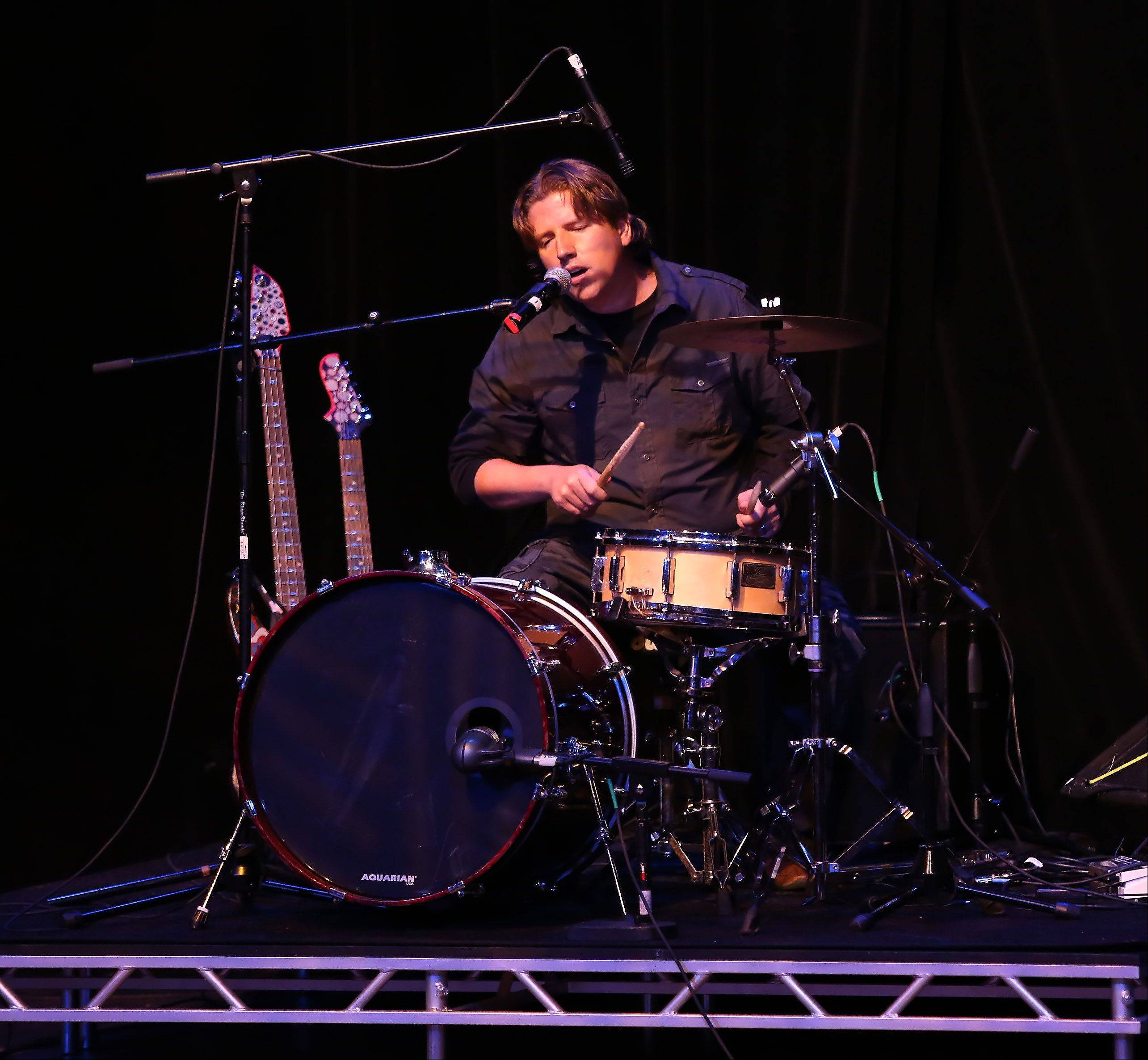 Dave Siemiaszko of Wheeling plays drums and guitar during Suburban Chicago's Got Talent competition Sunday night at the Metropolis Performing Arts Centre in Arlington Heights. The summer long talent contest is presented by the Daily Herald and sponsored by the Arlington Heights Chamber of Commerce.