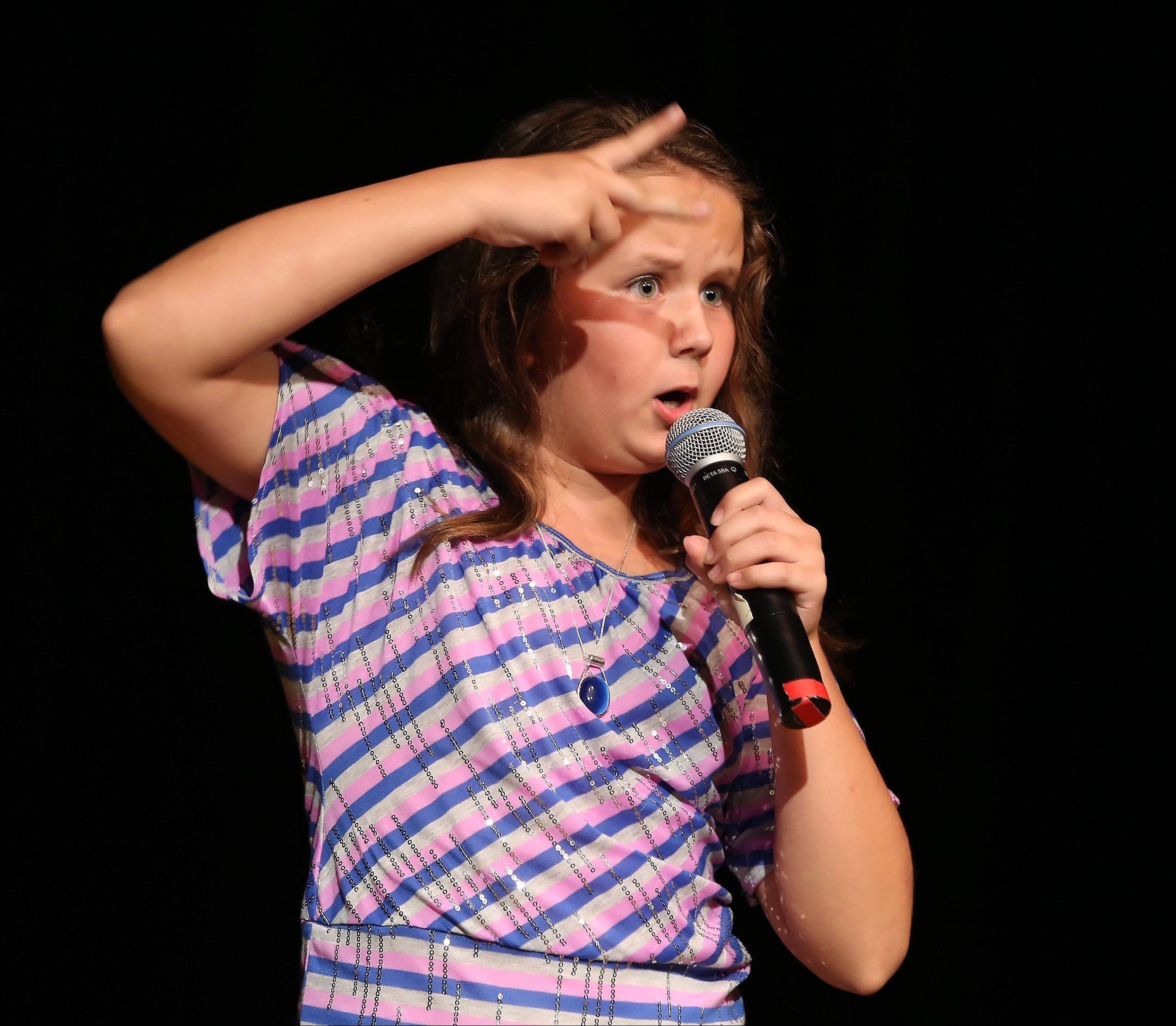 Mary Hilbrink of Fox River Grove sings and dances during Suburban Chicago's Got Talent competition Sunday night at the Metropolis Performing Arts Centre in Arlington Heights. The summer long talent contest is presented by the Daily Herald and sponsored by the Arlington Heights Chamber of Commerce.