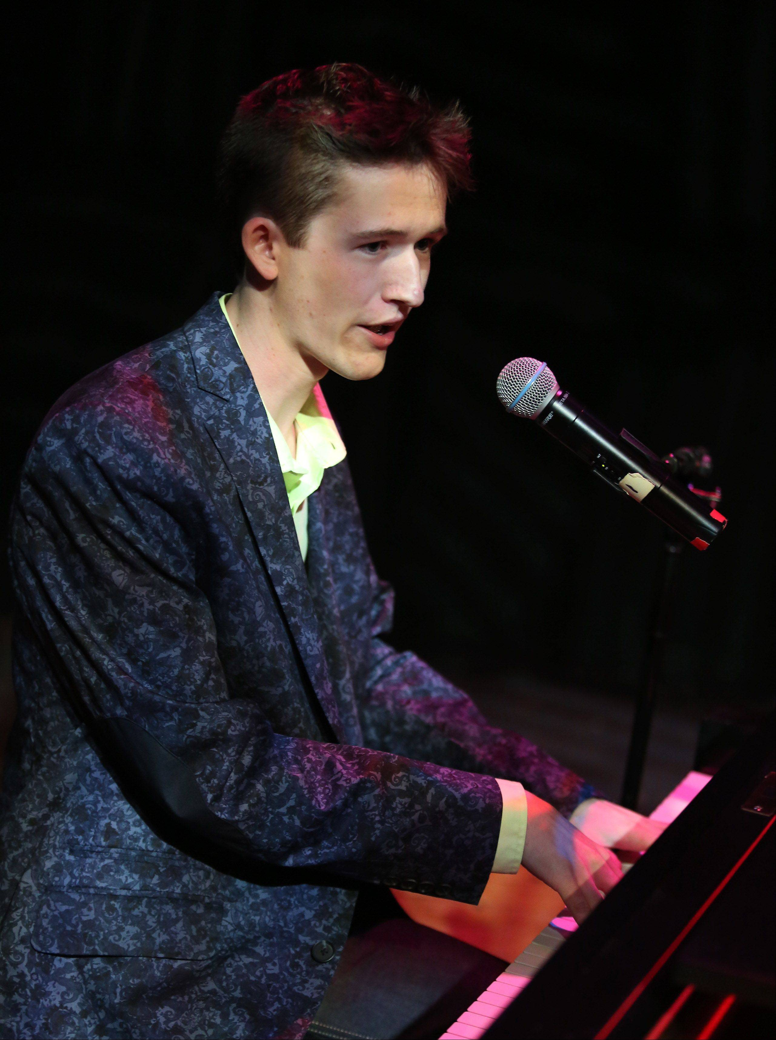 Riley Mangan of Arlington Heights plays the piano during Suburban Chicago's Got Talent competition Sunday night at the Metropolis Performing Arts Centre in Arlington Heights. The summer long talent contest is presented by the Daily Herald and sponsored by the Arlington Heights Chamber of Commerce.