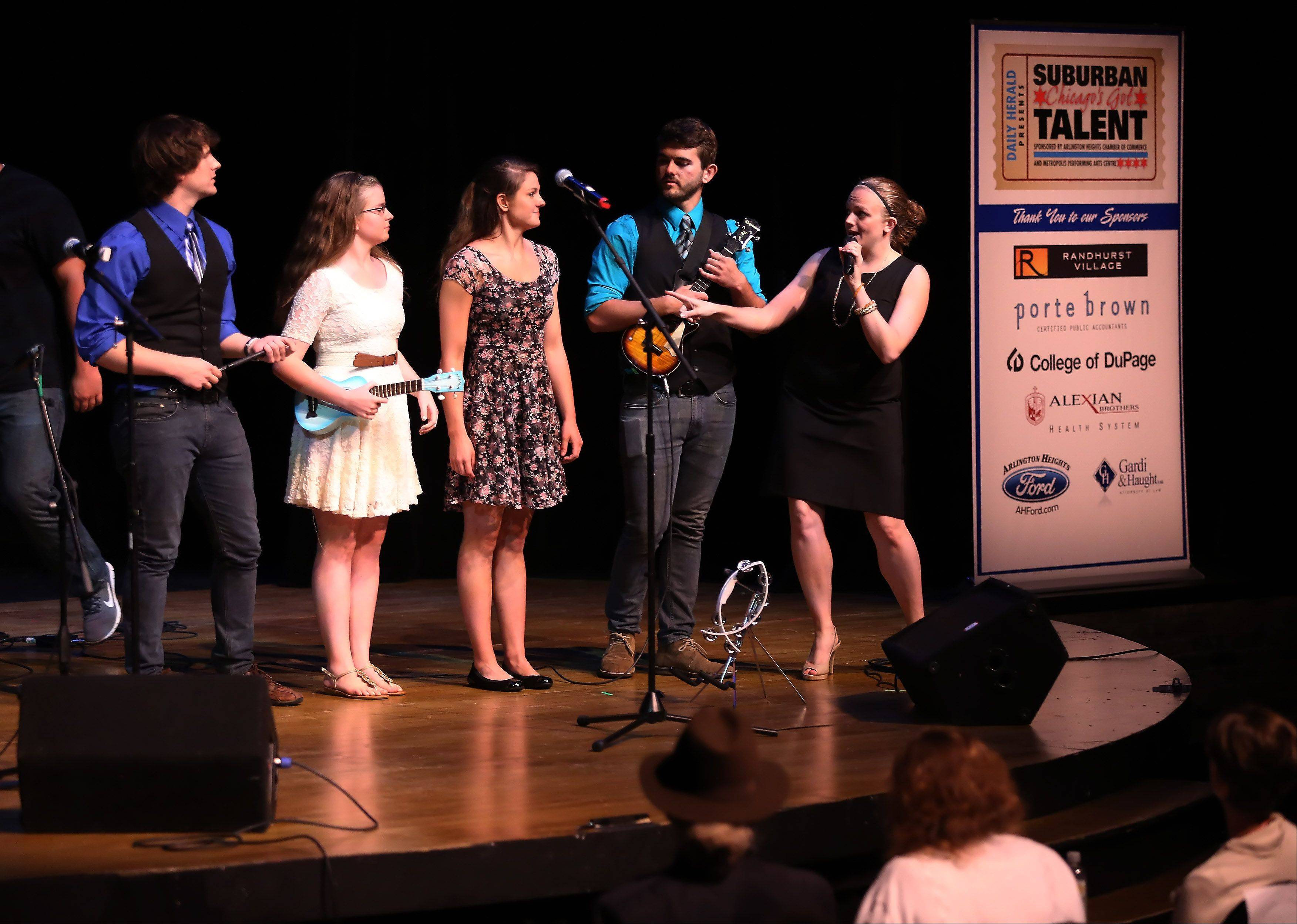 MC Michelle Shaver talks with the band No Immunity during Suburban Chicago's Got Talent competition Sunday night at the Metropolis Performing Arts Centre in Arlington Heights. The summer long talent contest is presented by the Daily Herald and sponsored by the Arlington Heights Chamber of Commerce.