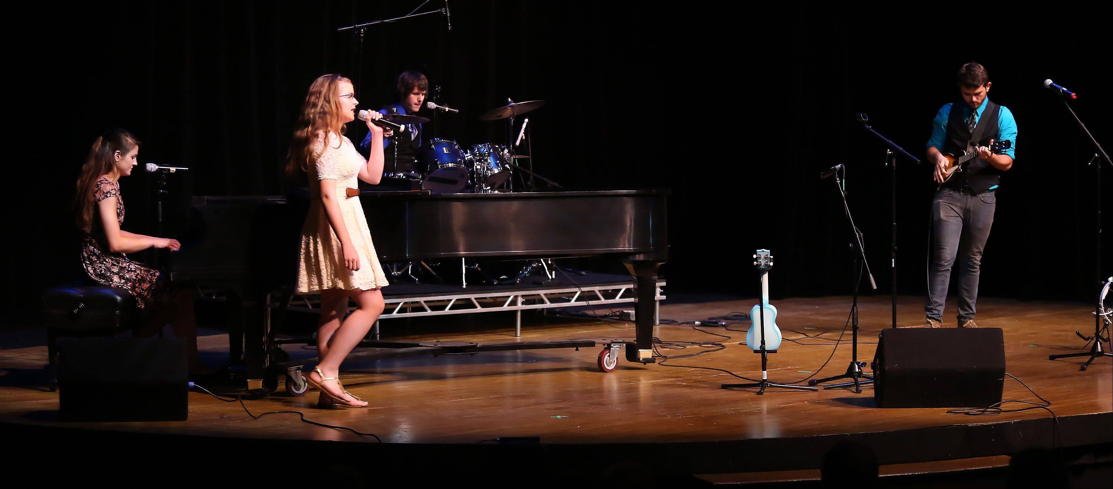 The band No Immunity of Arlington Heights performs during Suburban Chicago's Got Talent competition Sunday night at the Metropolis Performing Arts Centre in Arlington Heights. The summer long talent contest is presented by the Daily Herald and sponsored by the Arlington Heights Chamber of Commerce.