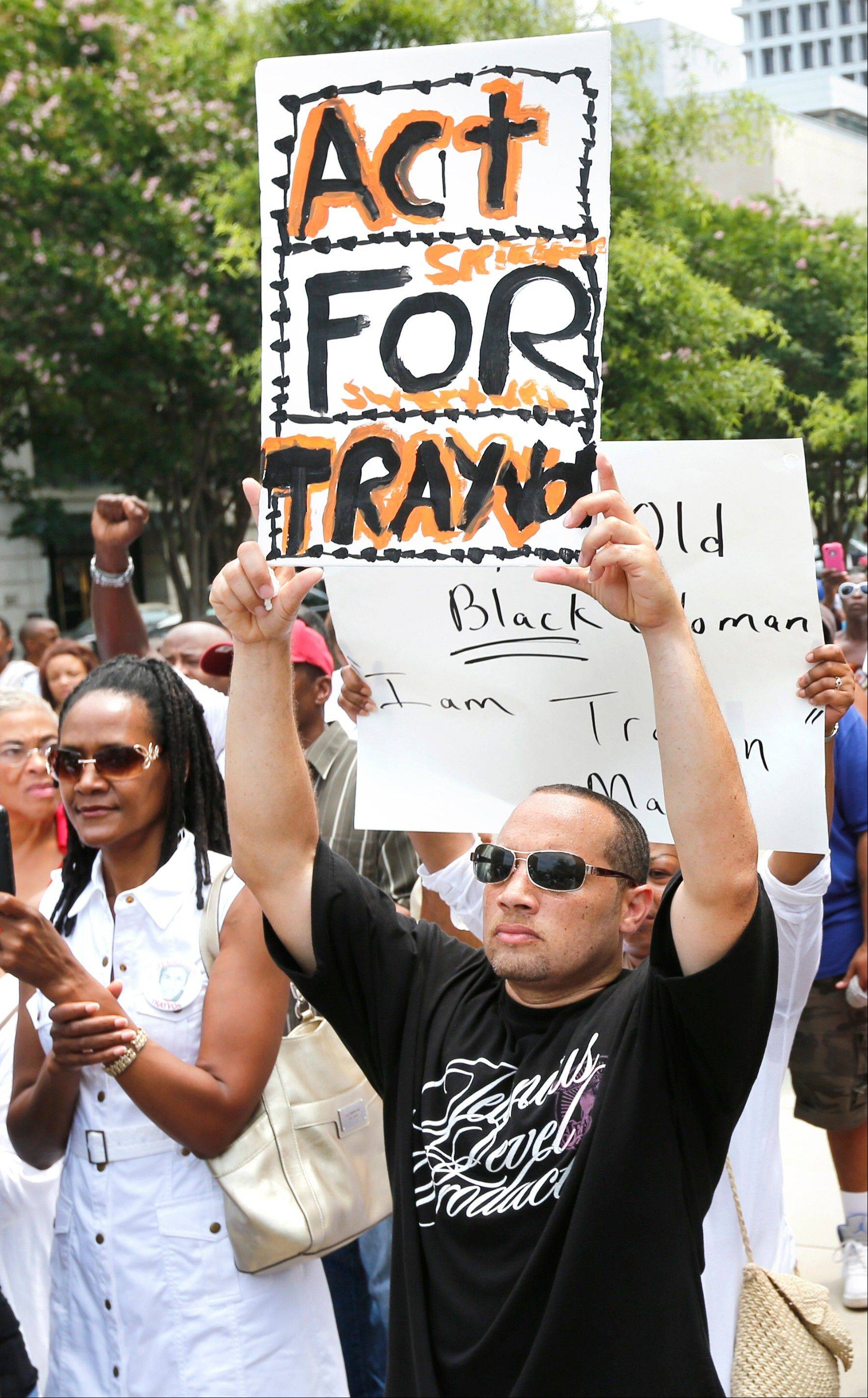 A man demonstrates Saturday at the federal courthouse in Richmond, Va., part of the Rev. Al Sharpton's National Action Network nationwide rallies to press for federal civil rights charges against George Zimmerman.
