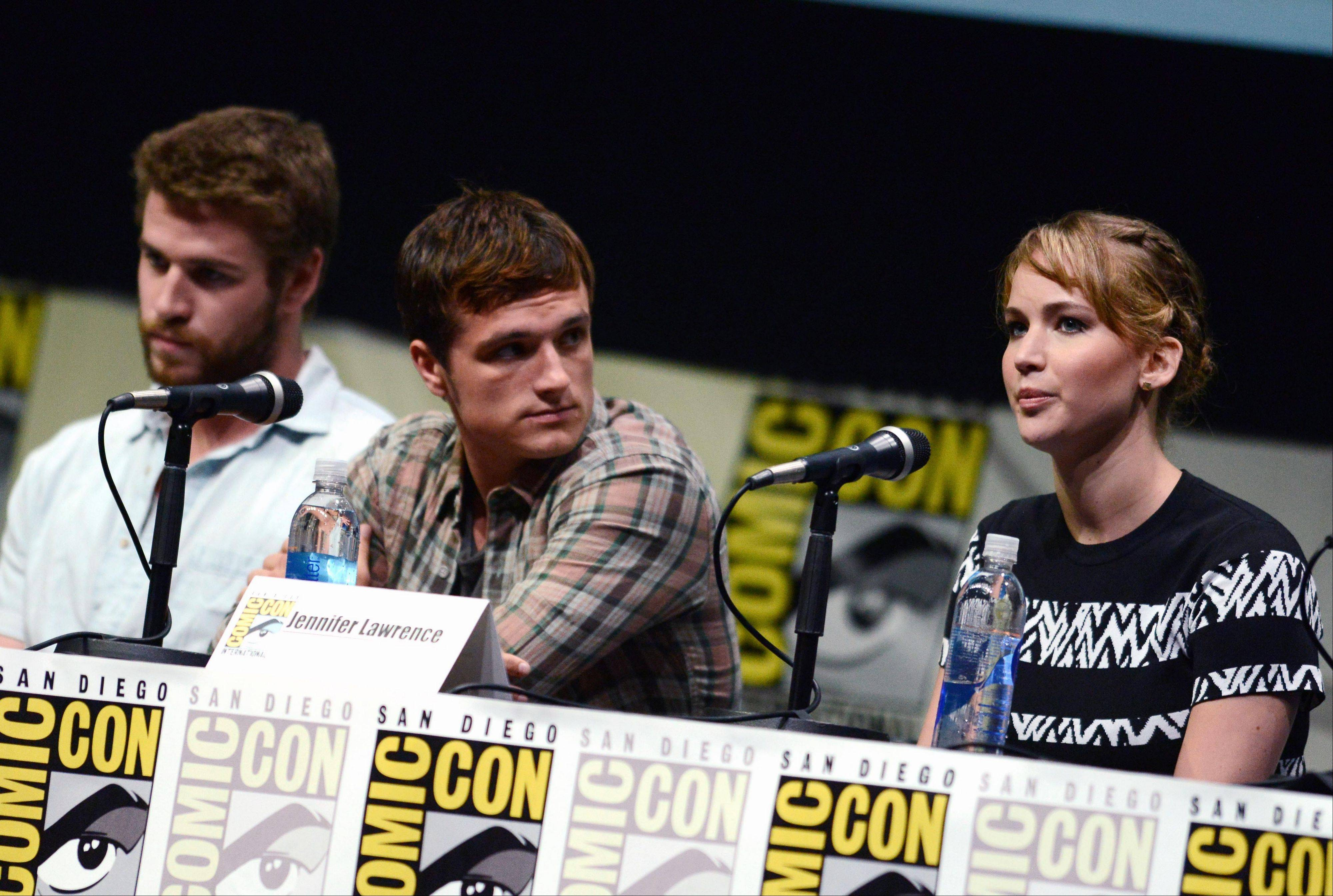 "From left, Liam Hemsworth (Gale Hawthorne), Josh Hutcherson (Peeta Mellark) and Jennifer Lawrence (Katniss Everdeen) attend the ""The Hunger Games: Catching Fire"" panel Saturday at Day 4 of Comic-Con International in San Diego. ""Catching Fire"" opens Nov. 22 in theaters."