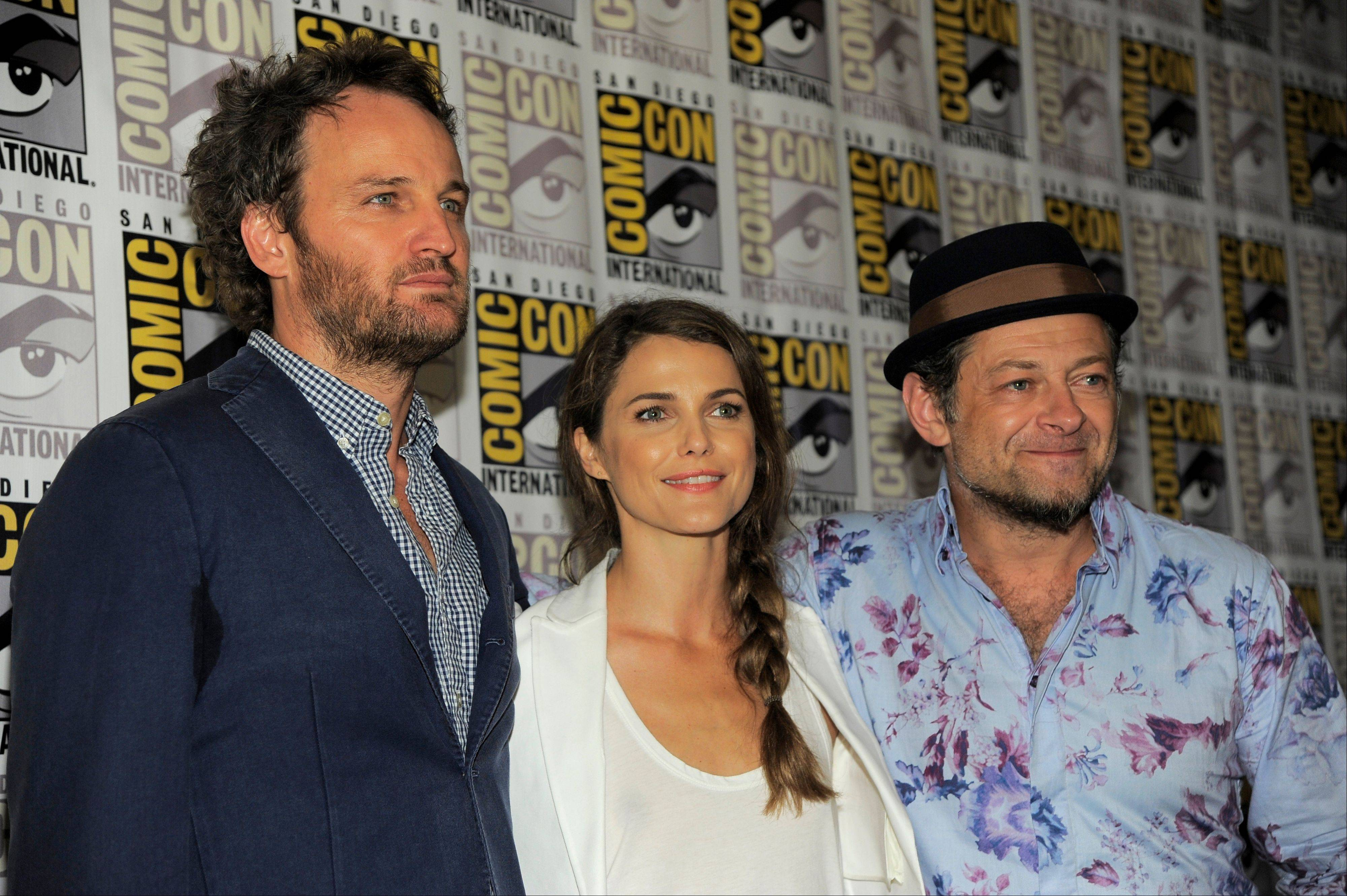 "From left, Jason Clarke, Keri Russell and Andy Serkis attend the ""Dawn of the Planet of the Apes"" press line Saturday at Comic-Con International in San Diego. Andy Serkis will reprise his motion-captured role of Caesar the chimp in the sequel, which hits theaters July 18, 2014."